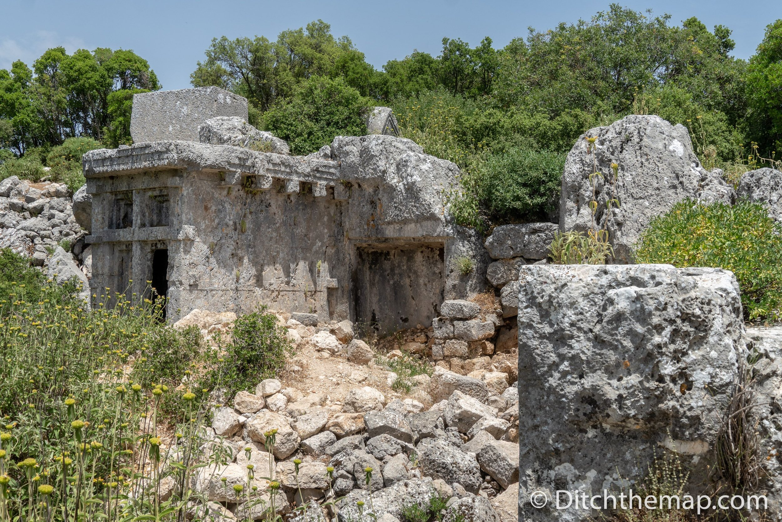 the remains of stone tombs at the ancient lycian city of phellos