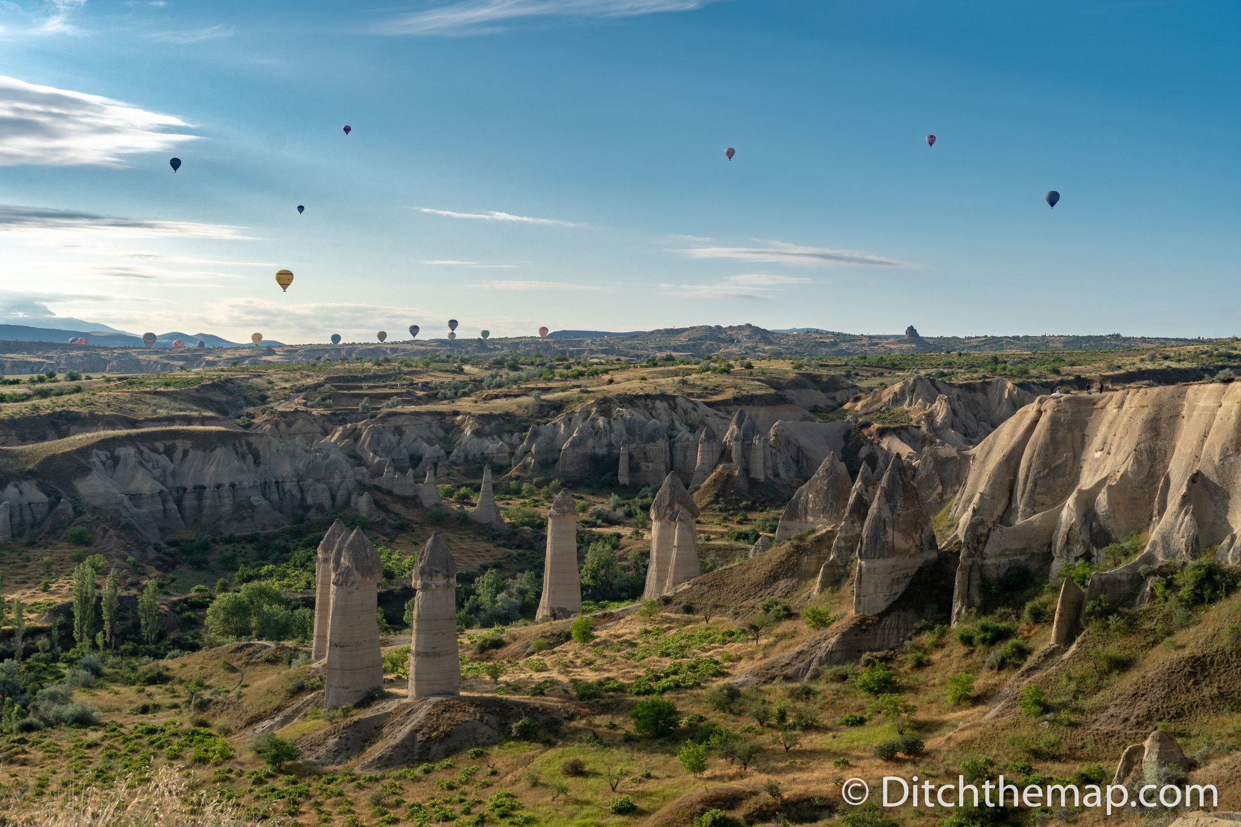 Monuments and balloons in sky