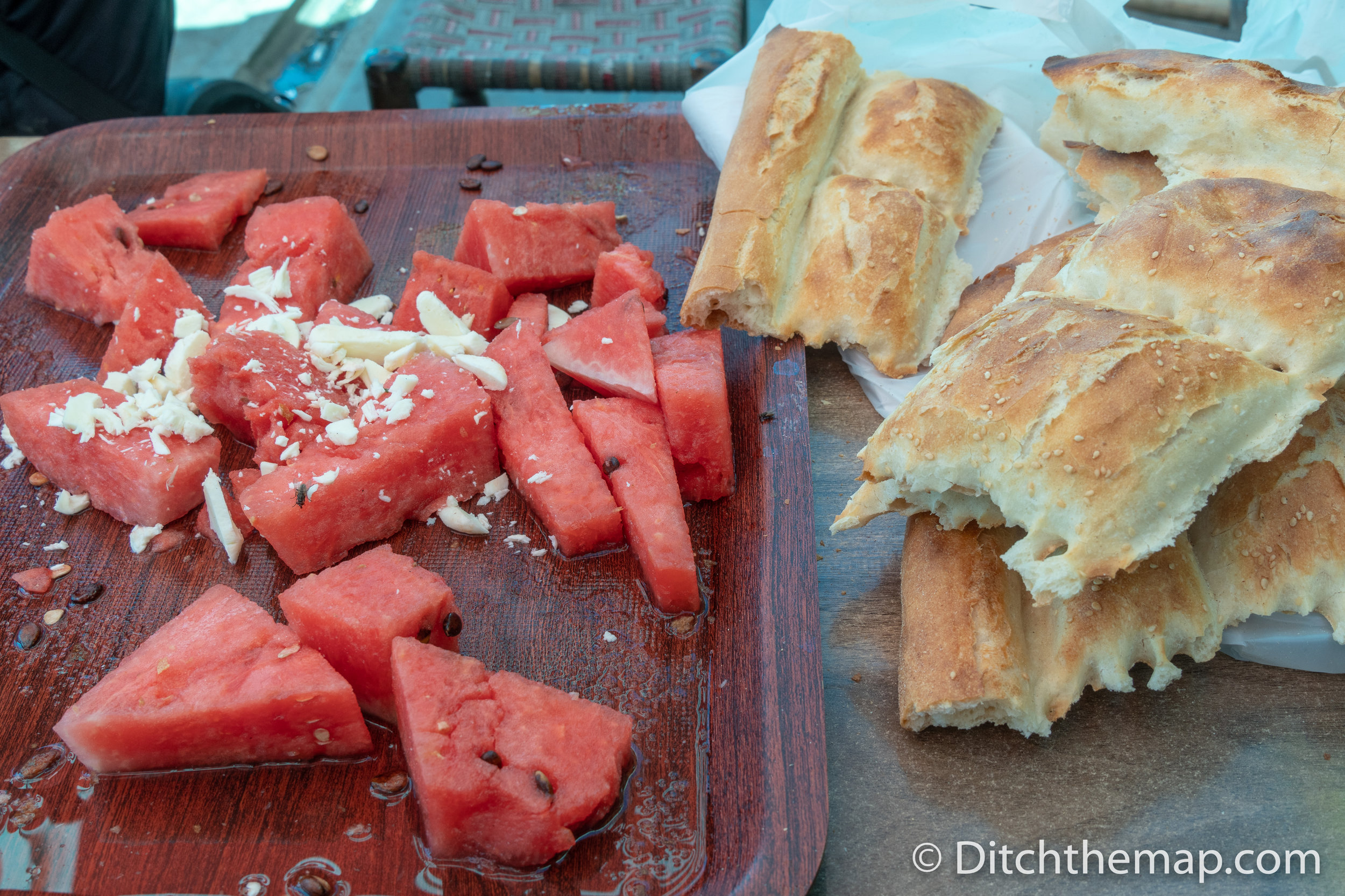 Eating watermelon, cheese, and bread on the streets