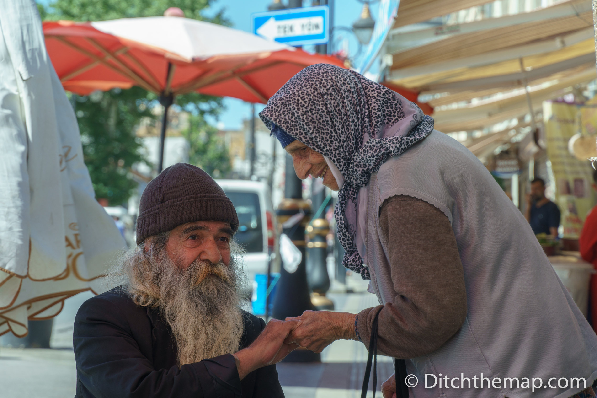 Man and woman share an embrace in Old City, Diyarbakir