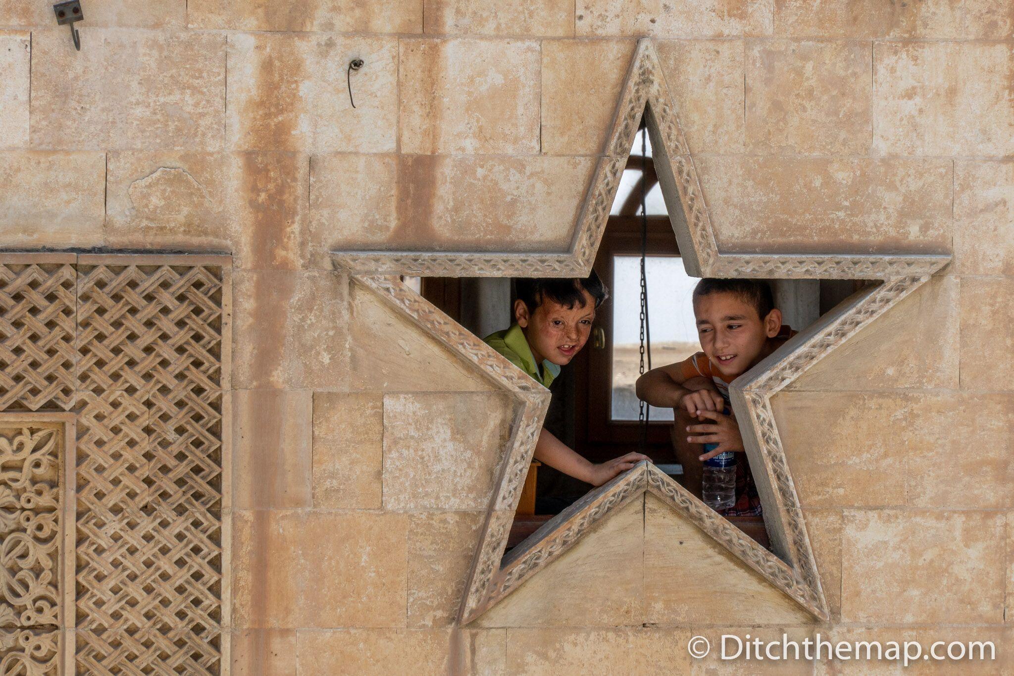 Children pose for a photograph in Mardin, Turkey