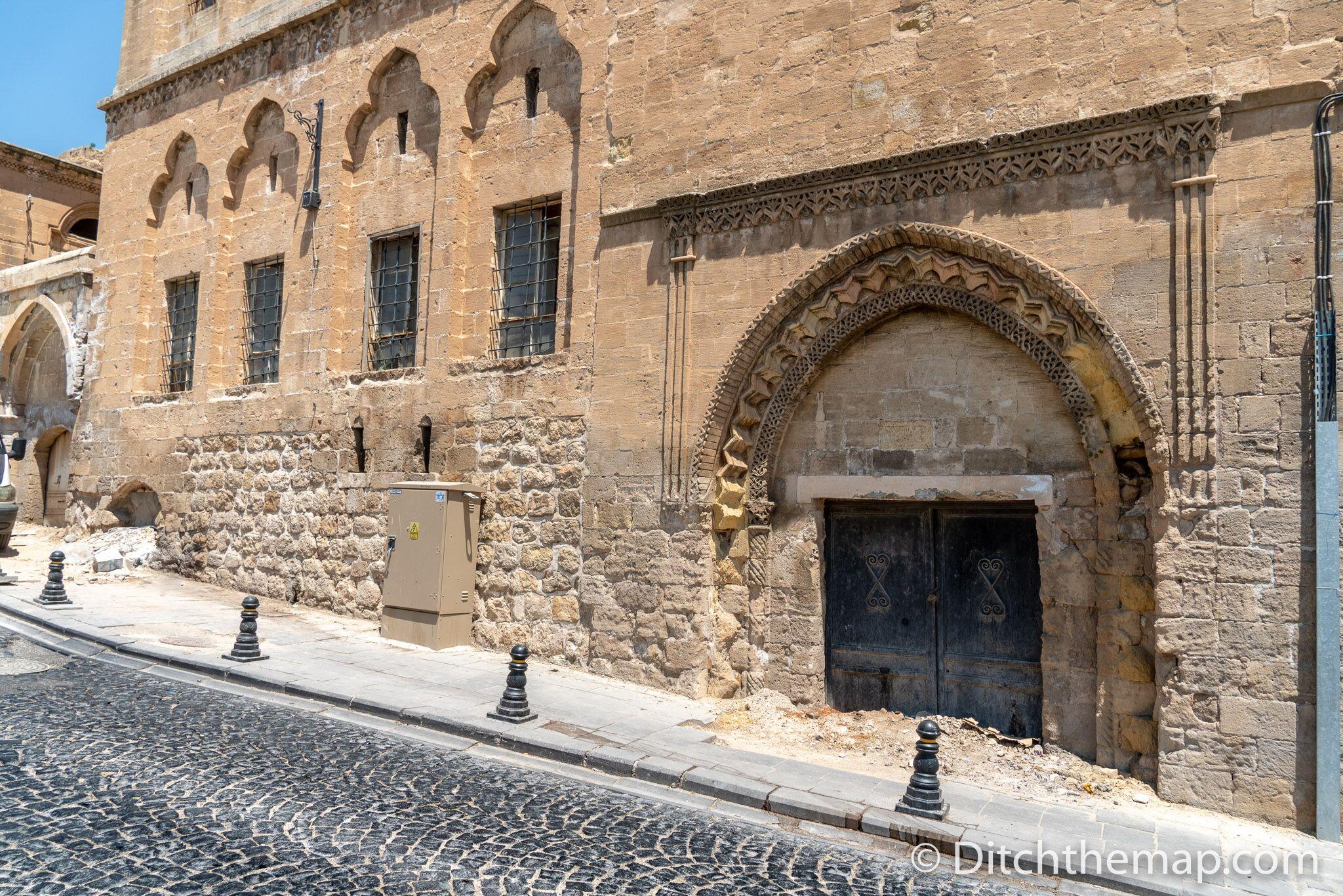 Old doorway in Mardin, Turkey almost buried by the street.