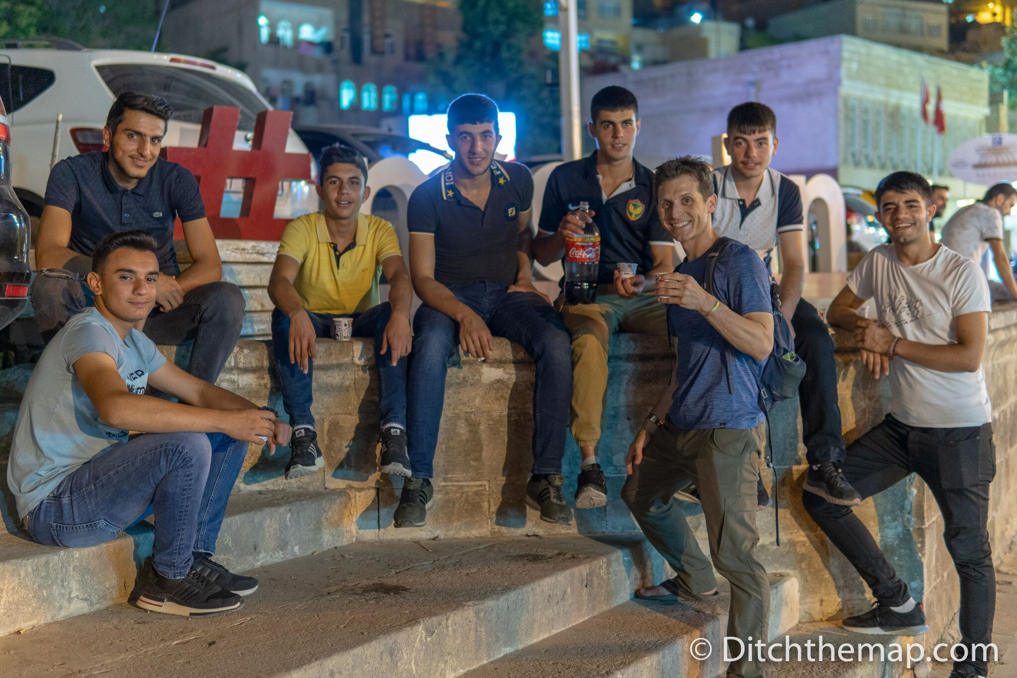 Group of teenage boys share their soda with us and ask for a photo