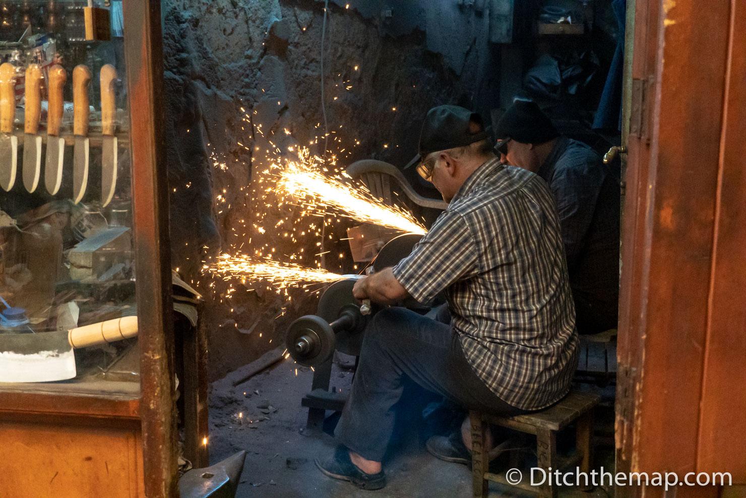 Man Sharpening Knife Blade