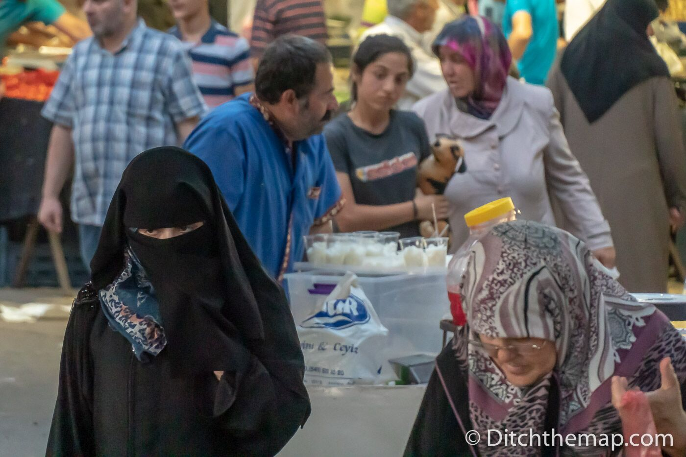 A woman wears a niqab in a market in Sanliurfa, Turkey
