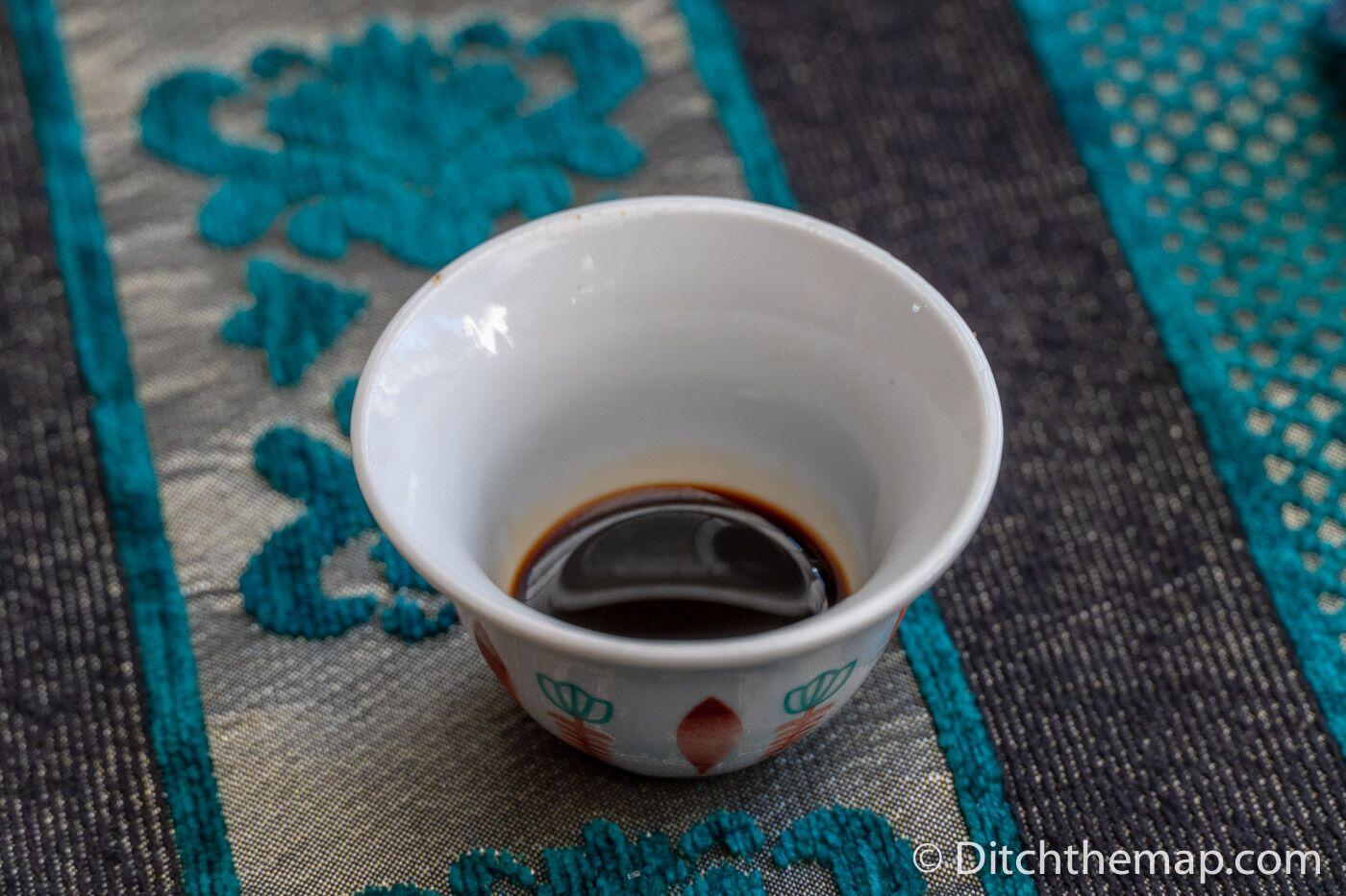 Specialty Mirra coffee is served as a single sip inside a tiny cup