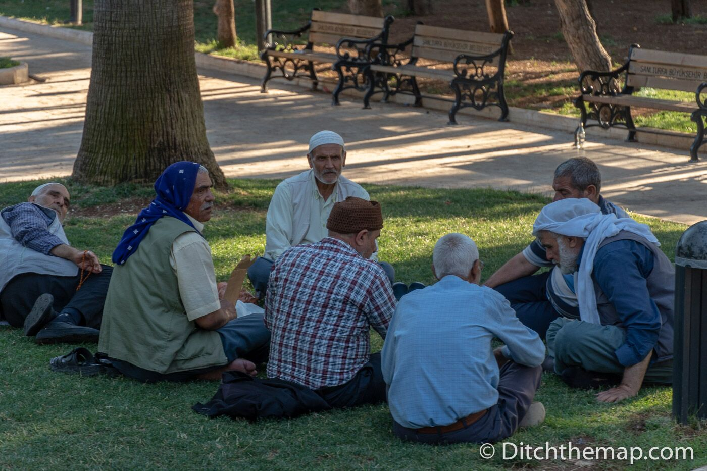 A group of men hang out in Golbasi park near Abraham's Cave in Sanliurfa, Turkey