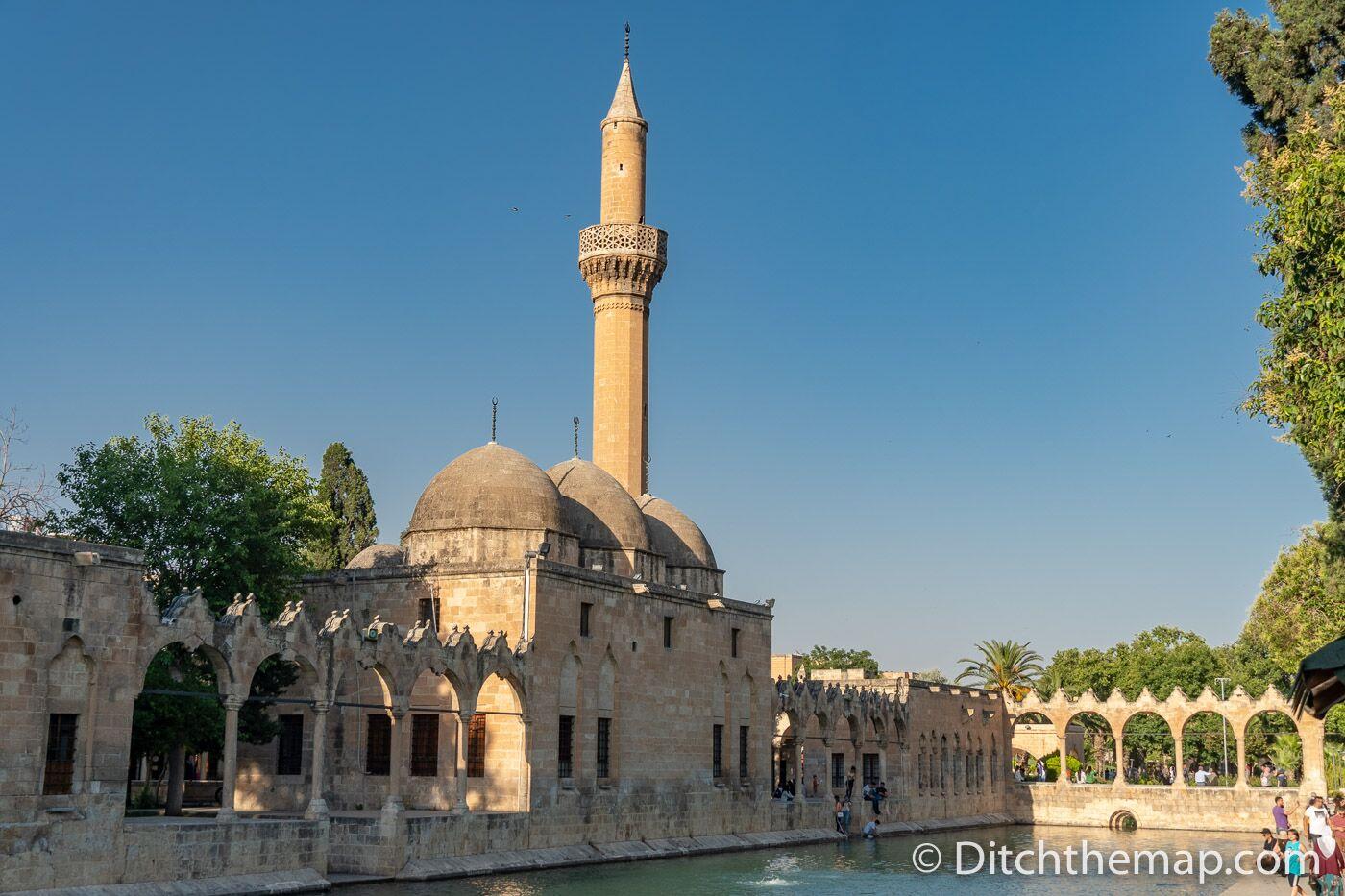 The Halil-ur-Rahman Mosque frames Balikli Gol, the pool of Abraham in Sanliurfa, Turkey
