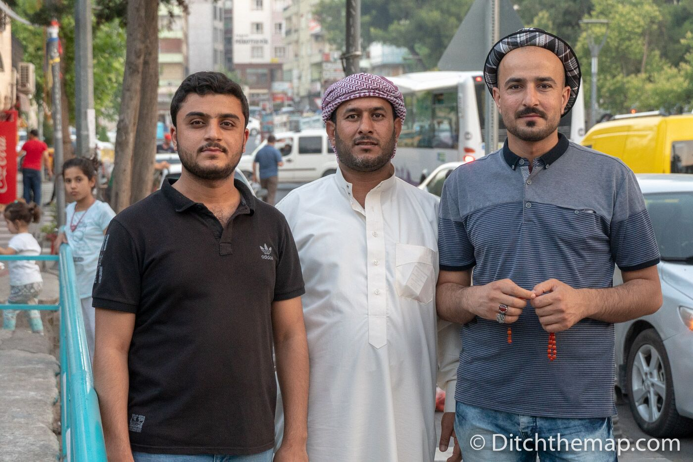 diverse group of men pose for picture in Sanliurfa Turkey