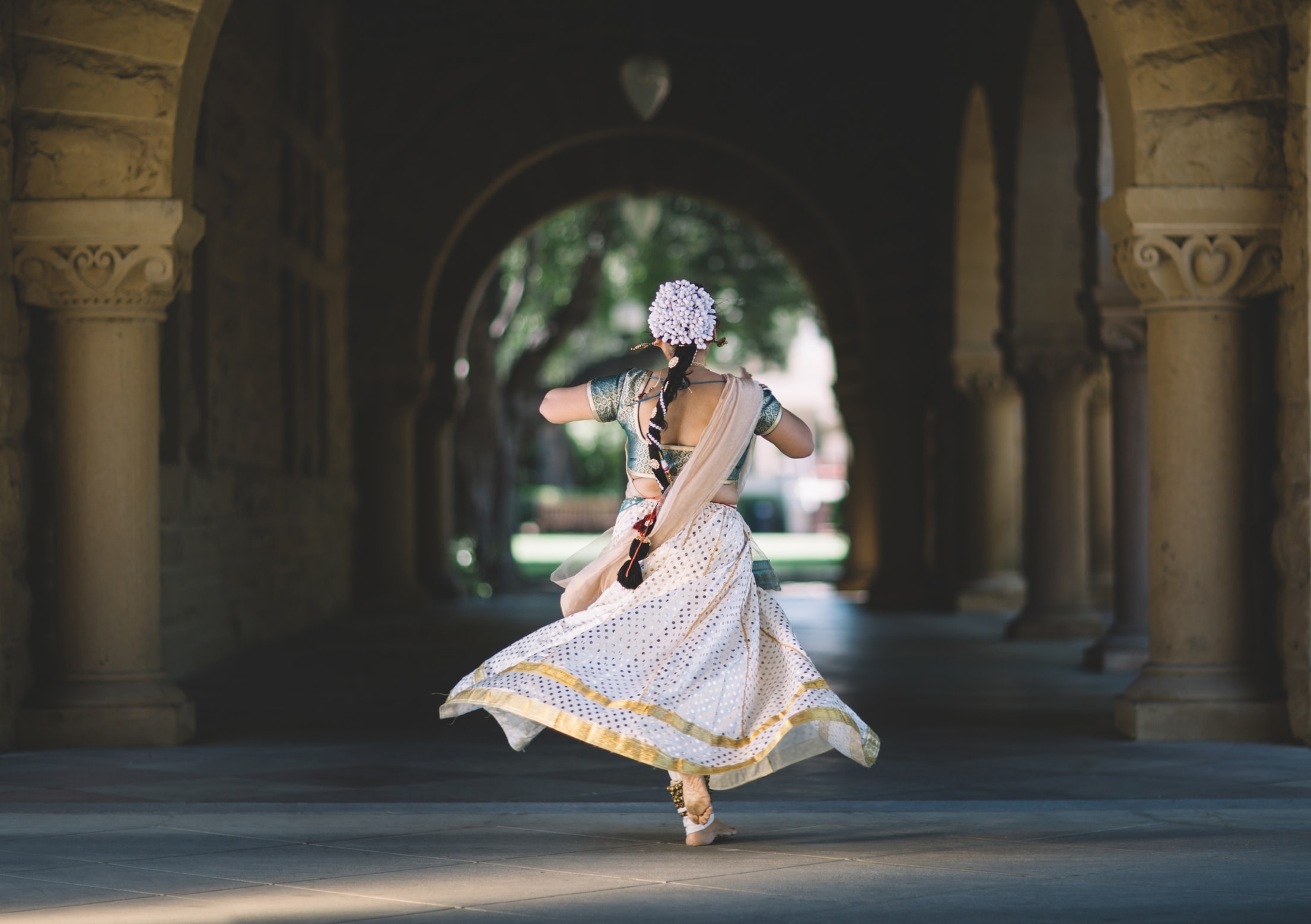 Indian woman spinning in Indian clothing