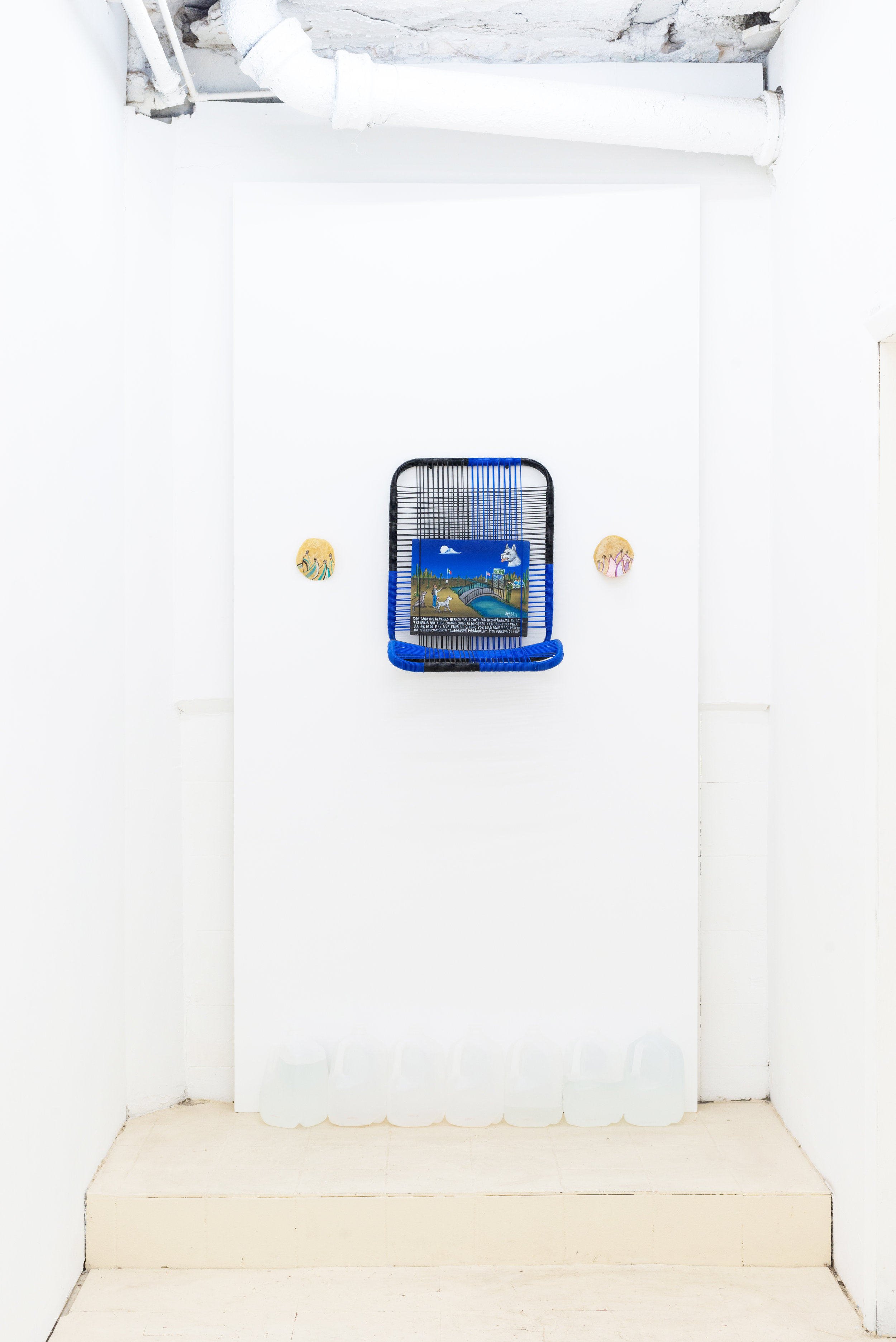 Guadalupe Maravilla   Milagros #1,  2019 Oil on tin, car seat, water jugs Dimensions variable