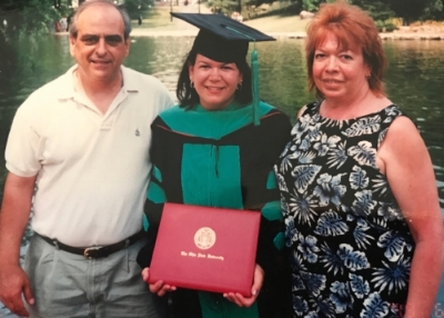 Dr. Mentessi and her parents on graduation day!