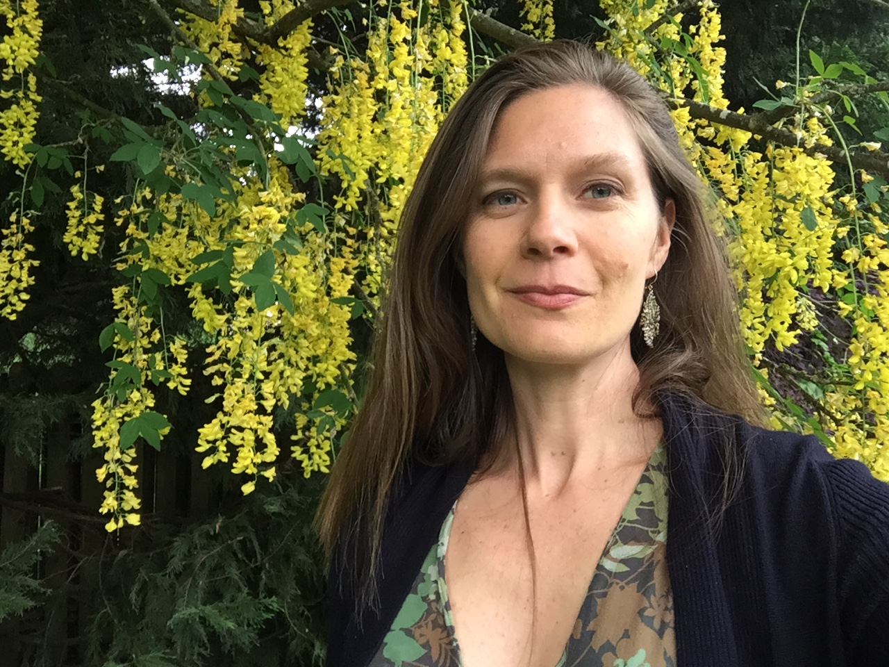 Picture of kate next to flowering tree