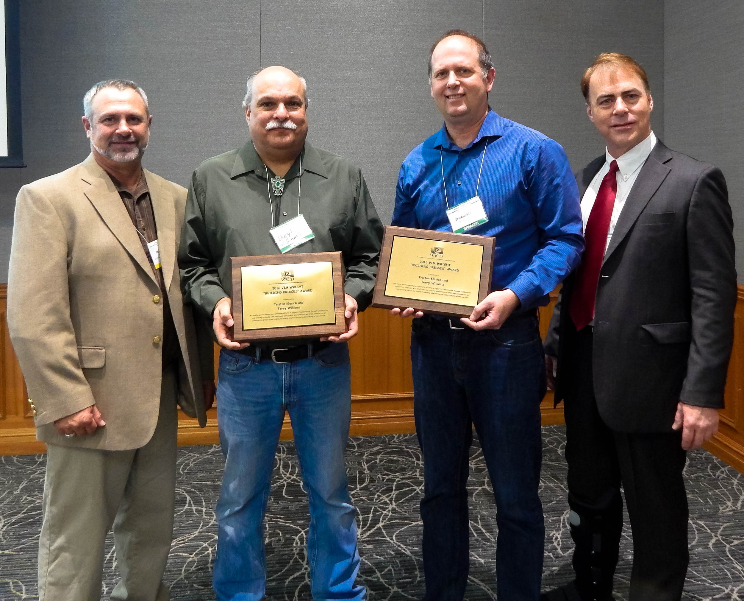 Mark Craven, left, WACD President, and Bob Schroeter, far right, WACD Executive Director, present Terry Williams (accepted by Daryl Williams, second from left) and Tristan Klesick with the 2016 Vim Wright Building Bridges award in Bellingham.     Photo credit:     Candra Grimm,   Legislative and Membership Assistant  ,   Washington Association of Conservation Districts