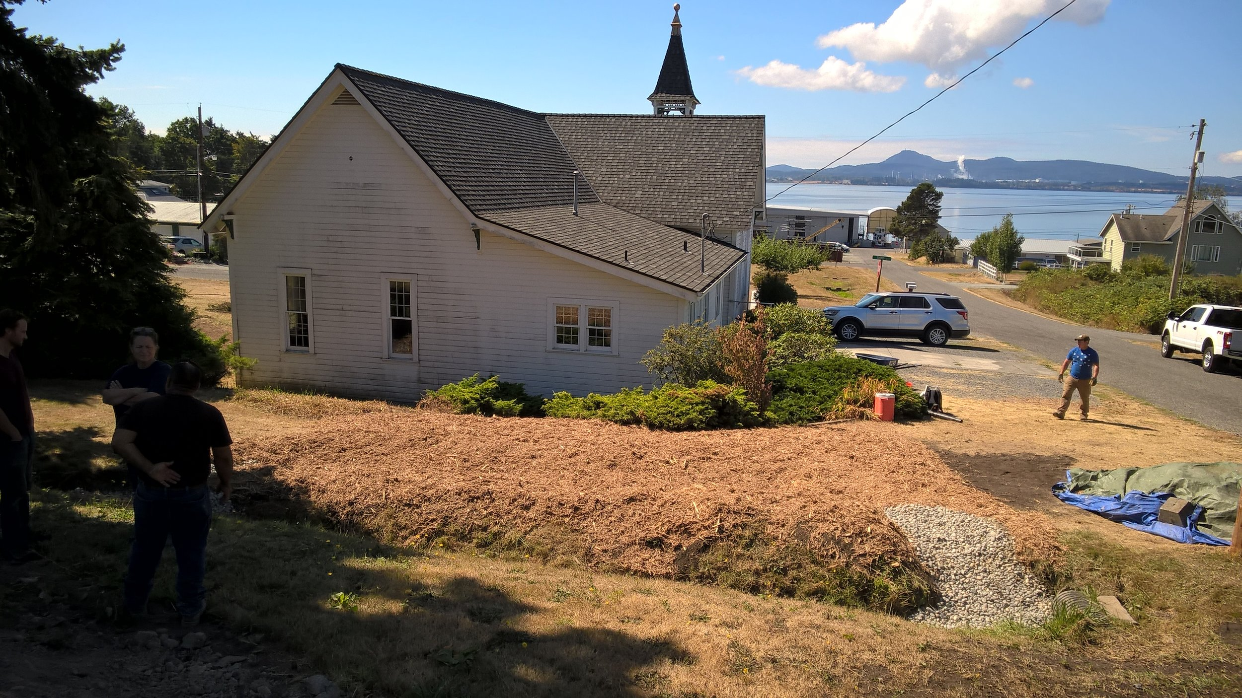 The fully prepped and ready for plants rain garden with padilla bay in the background