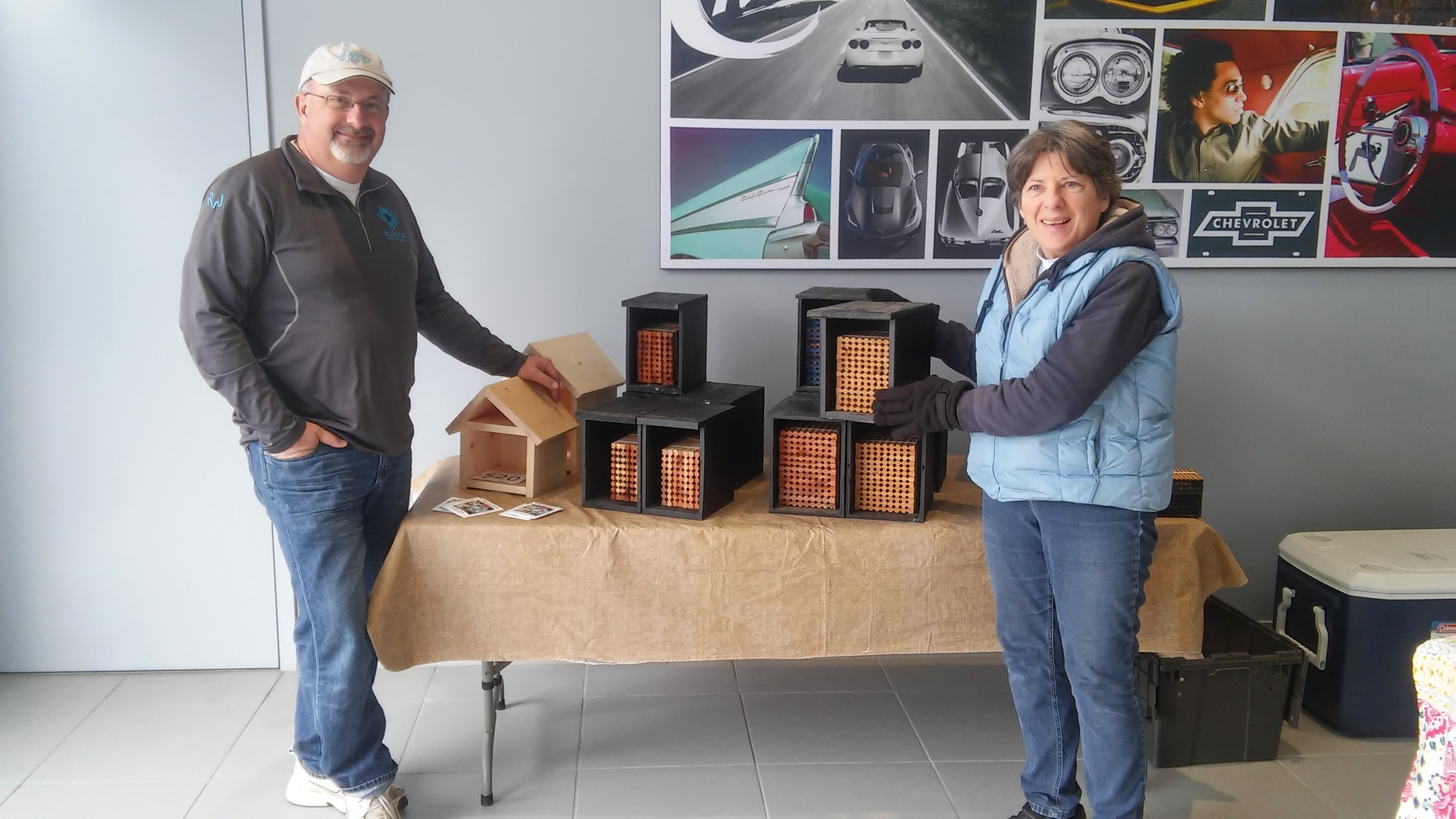 Jim Watts of Watts Solitary Bees and Missy Anderson, Rent Mason Bees, with some of their bee lodges.