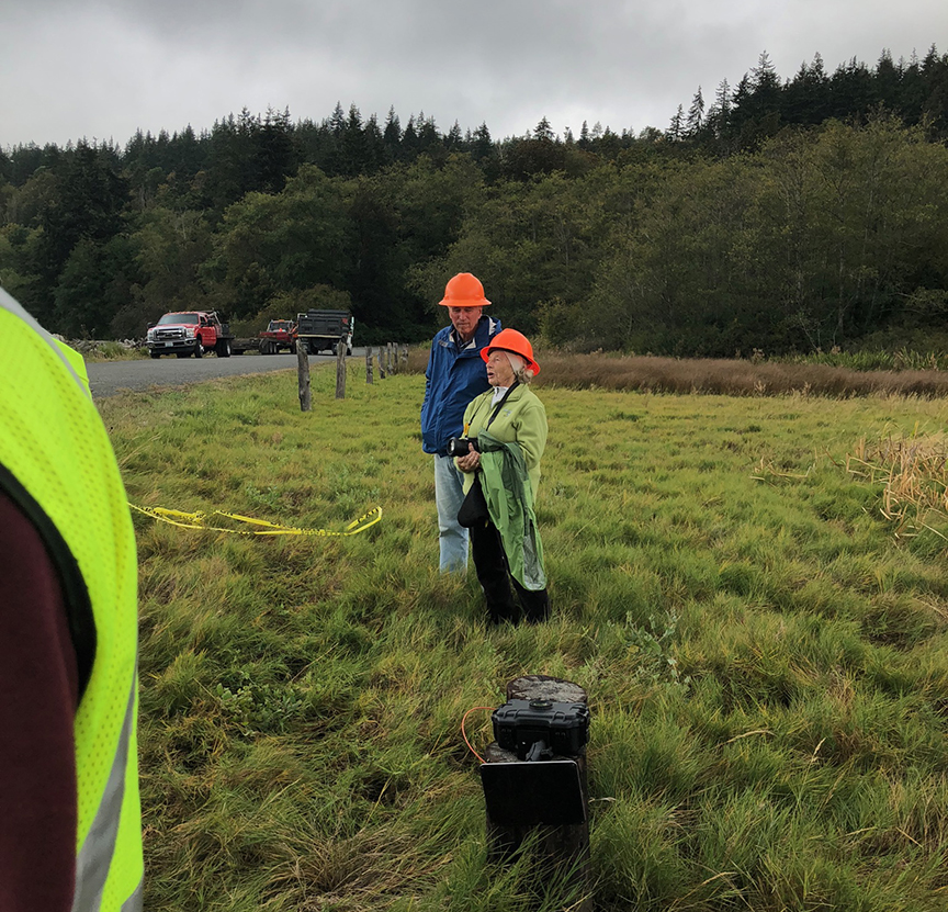 Original citizen volunteers who identified this project as a priority for salmon recovery, over 15 years ago. Barbara Brock and Bob Friedman watch as the box culvert sections are placed.