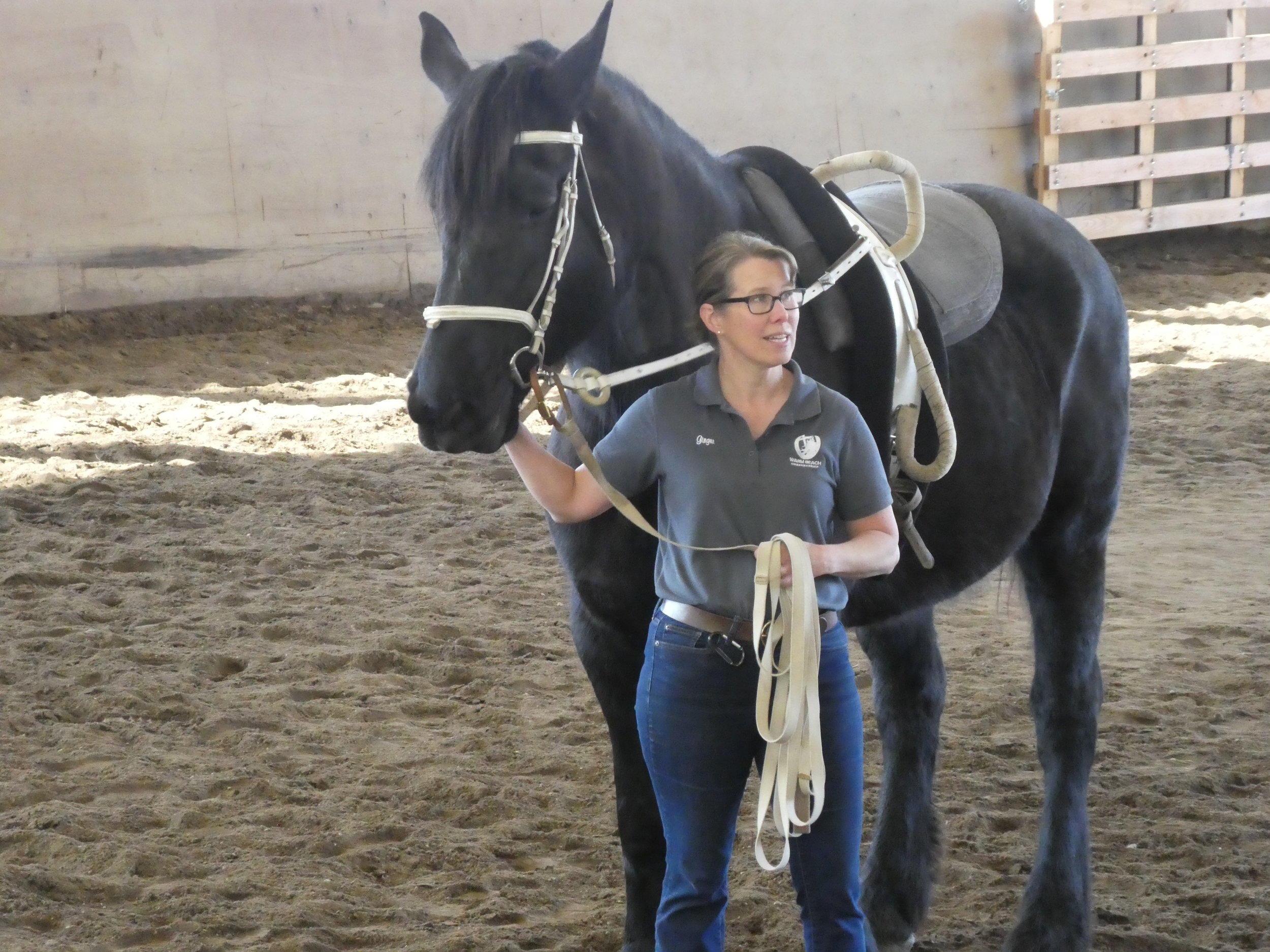 Ginger Reitz, Therapeutic Horsemanship Coordinator, with Freya in the vaulting surcingle.