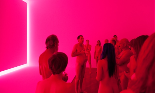 Stuart Ringholt leads his naked tour, standing in front of James Turrell's 1969 work Raemar pink white. Photograph: Christo Crocker/National Gallery of Australia