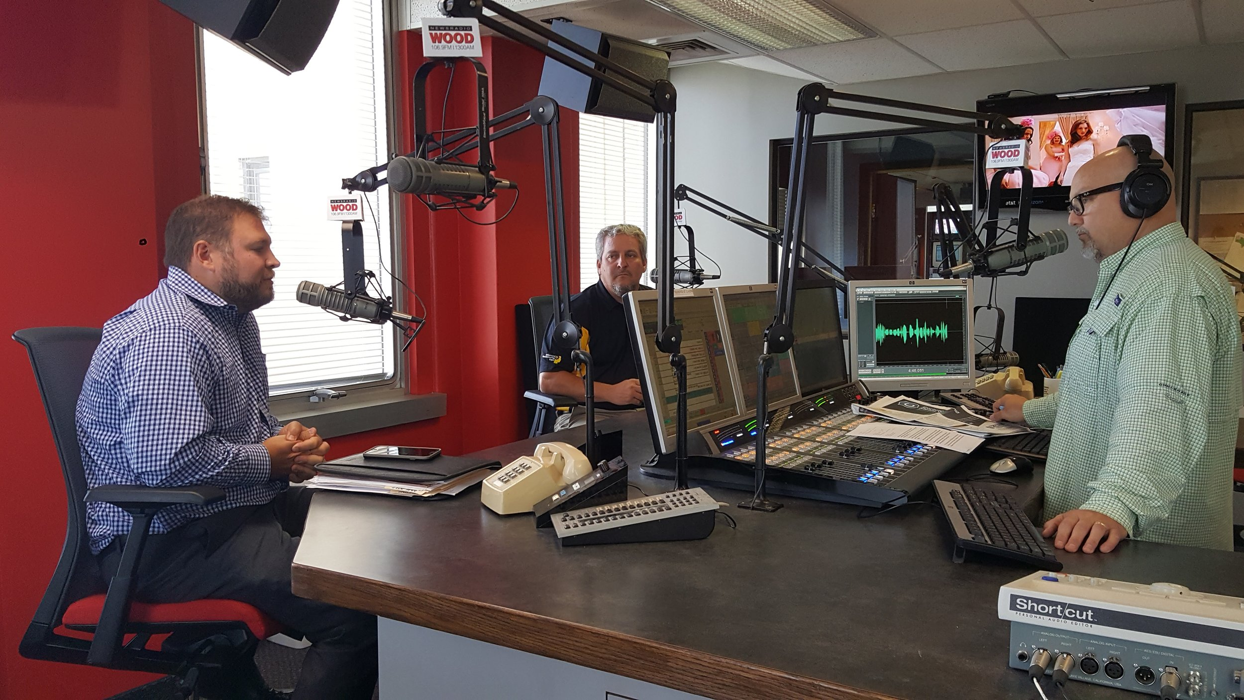 Paul Hendricks (left) and Mark Ermatinger (middle) on air with Steve Kelly (right) on WOOD 1300 AM and 106.9 FM