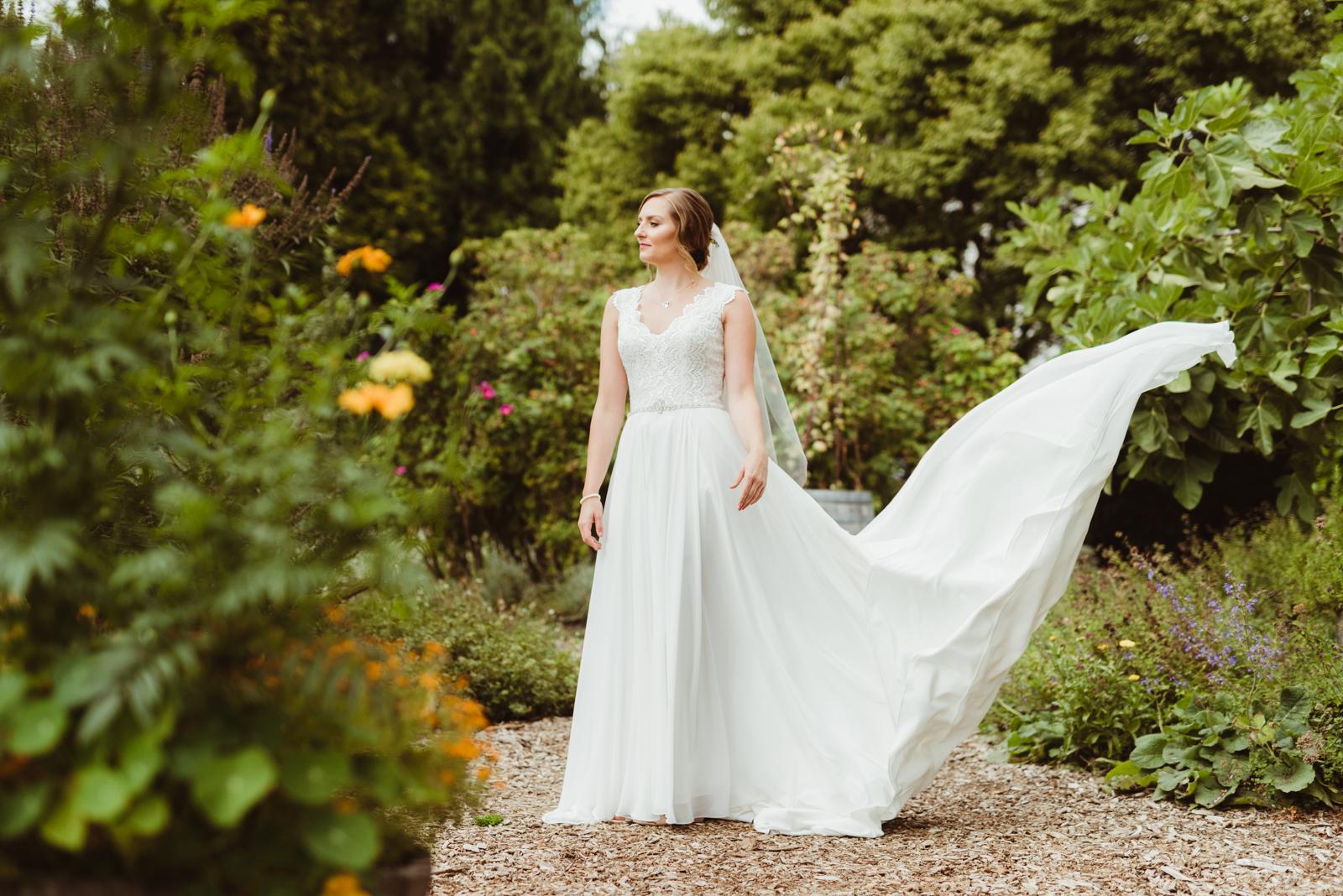 Bridal portrait with wind swept dress