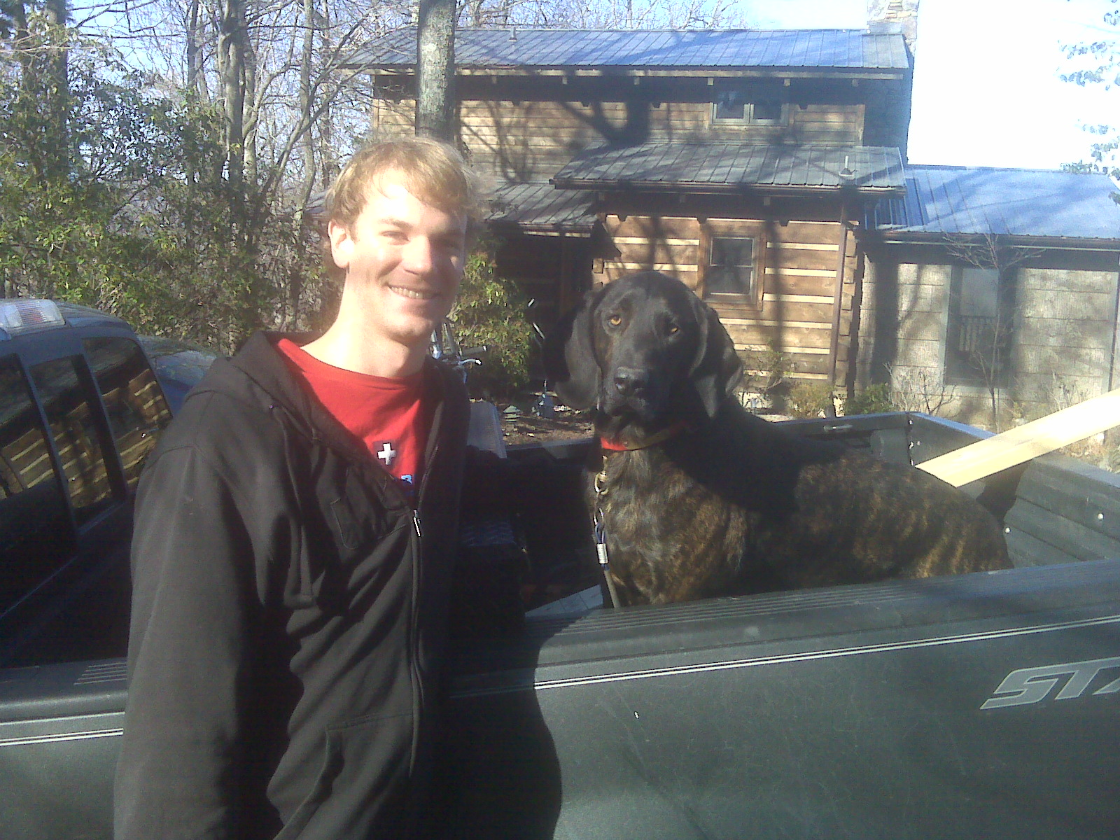Ted Edmunds with his dog, Wylie.  Wylie is a Plott Hound, the official state dog of North Carolina.