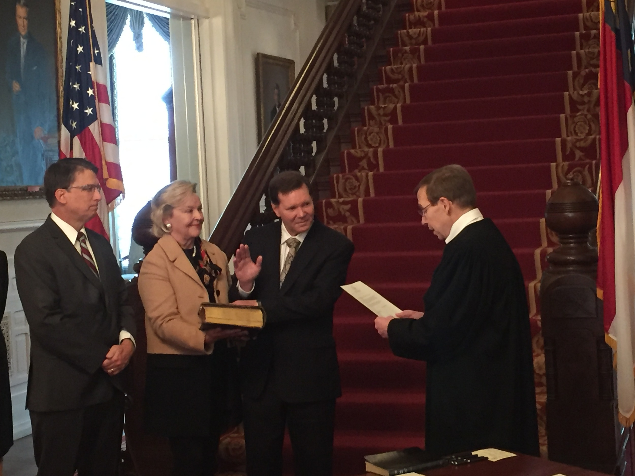 Administering oath of office to Industrial Commissioner Bill Daughtridge, Jr., at Governor's mansion, 18 February 2016.
