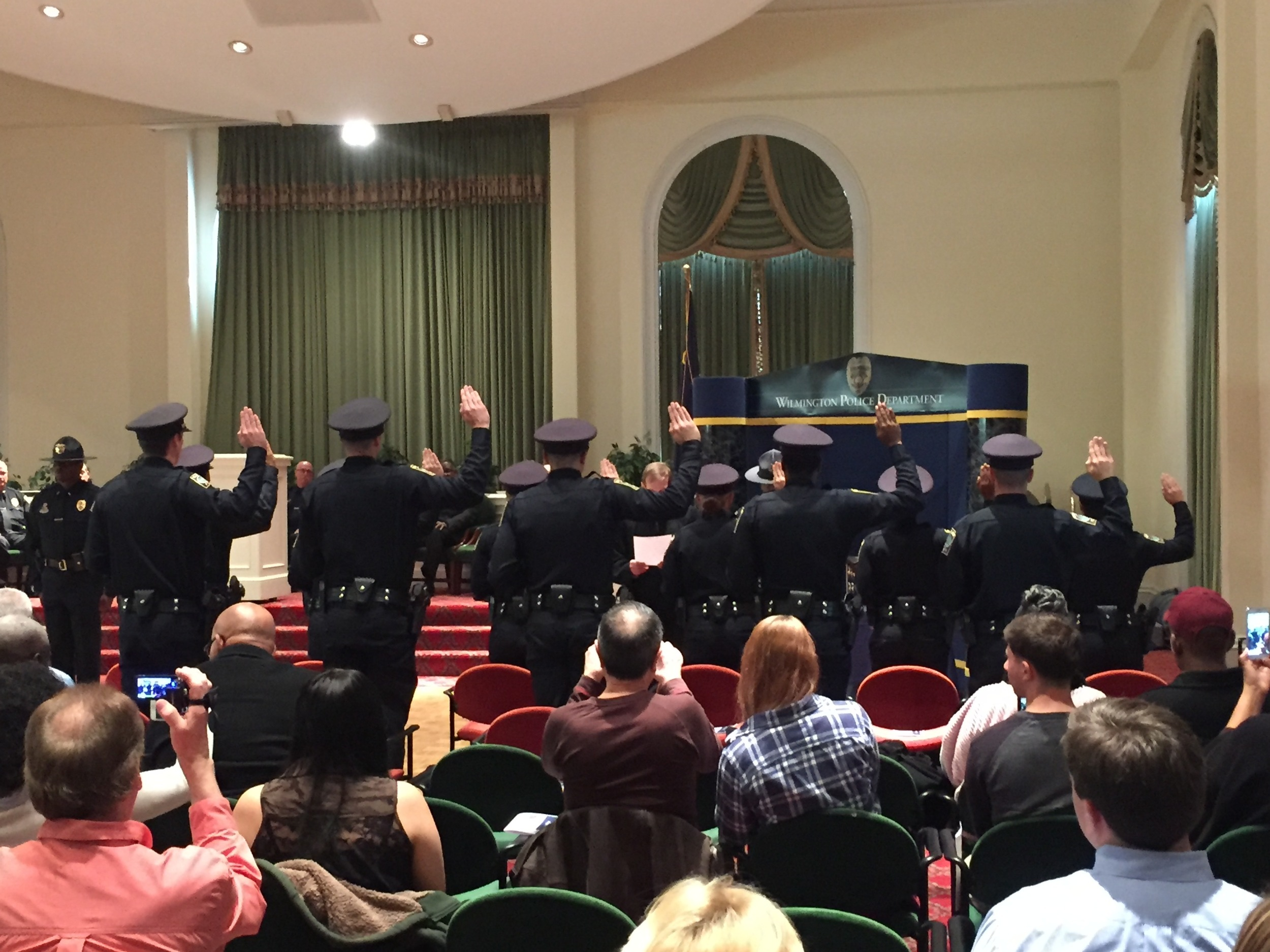 Administering oath of office to new police officers, Wilmington, March 4, 2016.