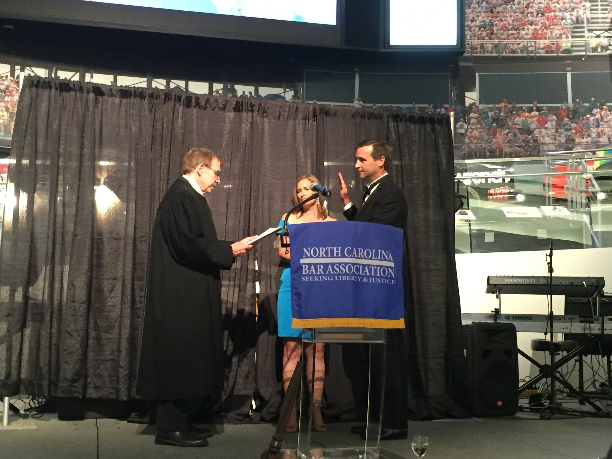 Administering oath of office to incoming N.C. Bar Association president Kearns Davis at NASCAR Hall of Fame, June 25, 2016.