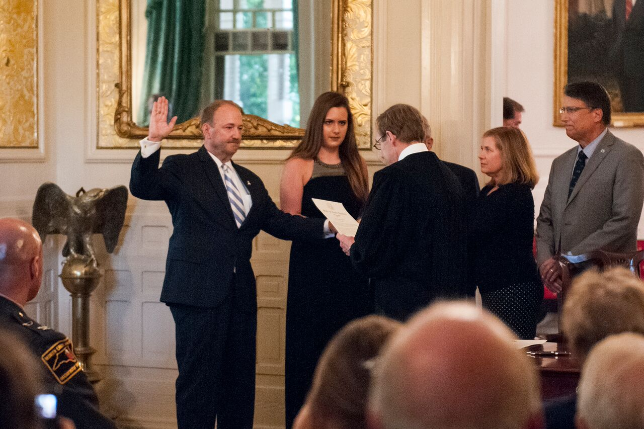 Administering the oath of office at the Governor's Mansion to incoming State Bureau of Investigation Director Robert Schurmeier, July 22, 2016.