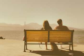 Couple sitting discussing life insurance
