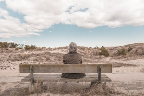 Retirement Social Security - Insurance agent sitting on bench in san diego desert