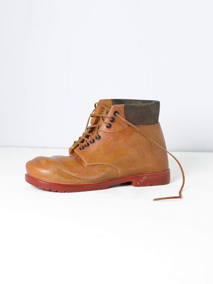 """Robin Antar, Work Boots with Rivets Med Brown, 2009, carved limestone and oils, 6.5""""h X 11.5""""w X 4.5""""d"""