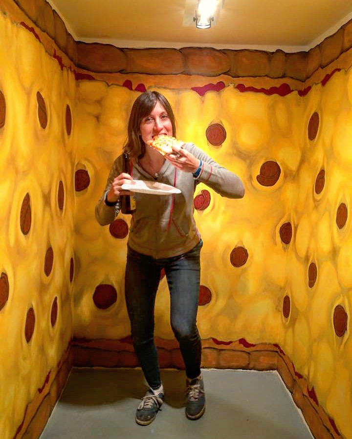 Hey there! this is me in a giant pizza i painted in a small gallery years ago…welcome welcome! grab a slice! oh wait, we're out…sorry, should have gotten here sooner…