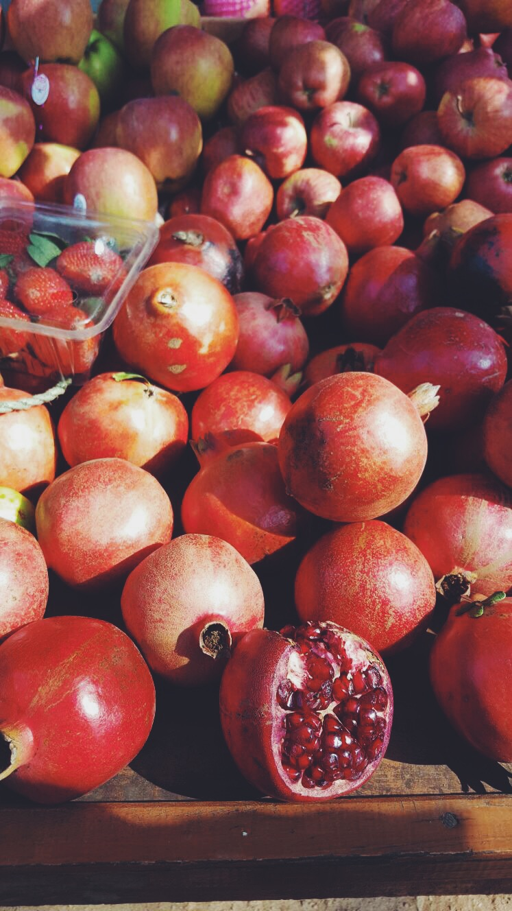 Buying one of my favorite fruits - pomegranates - from a road side stall!