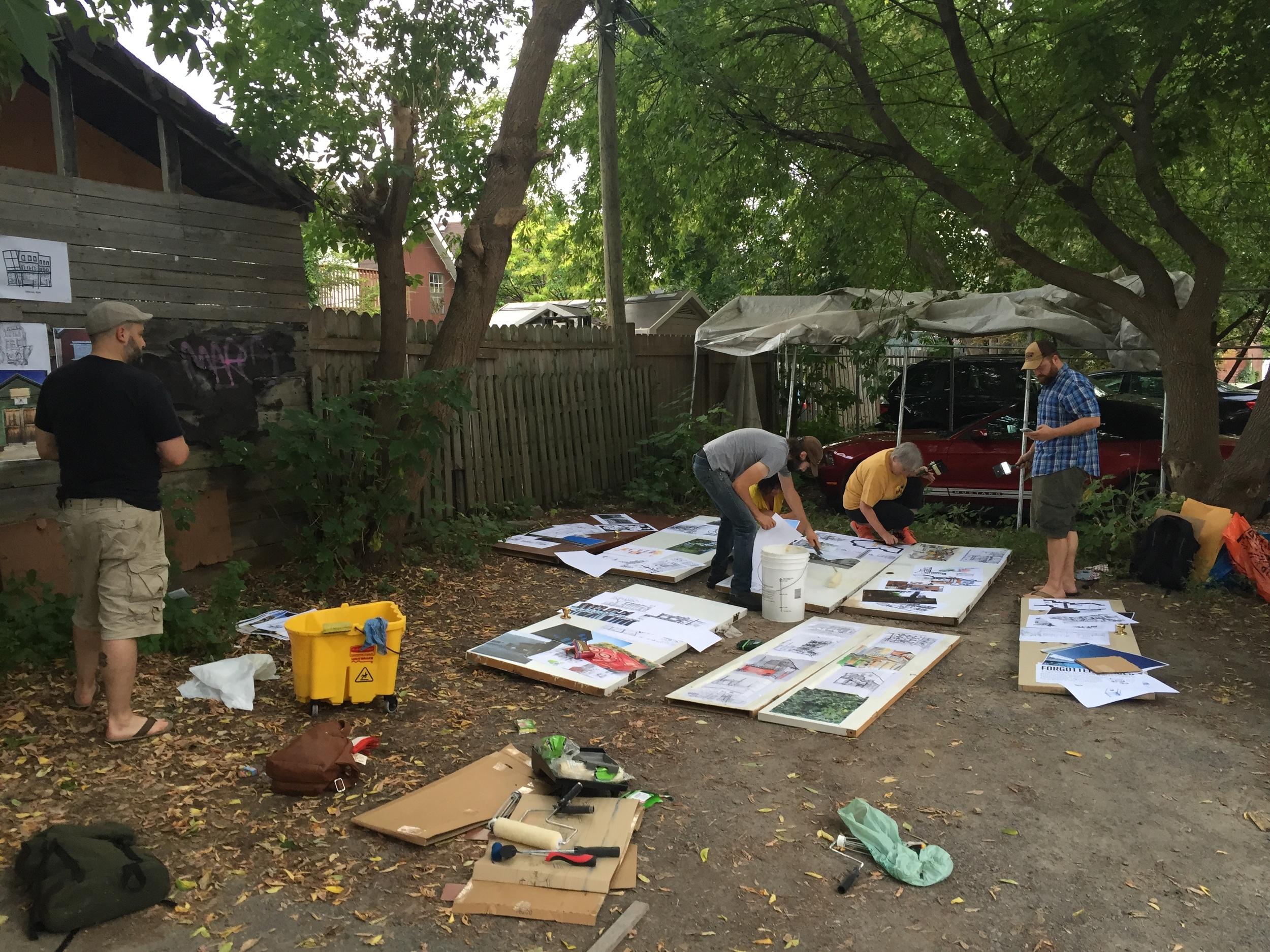(Stephen, Mawt, Kristina, Cindi and Marc wheat pasting art onto doors)