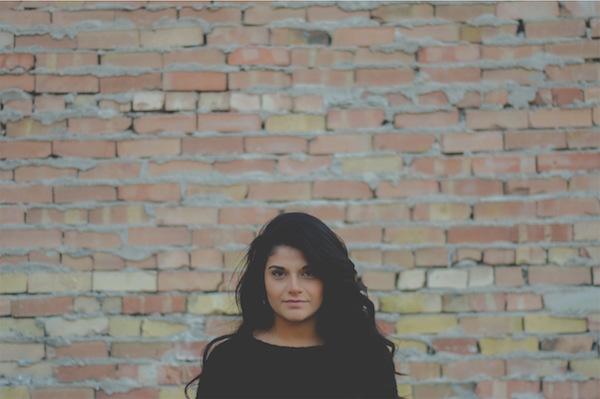woman brick wall.jpg