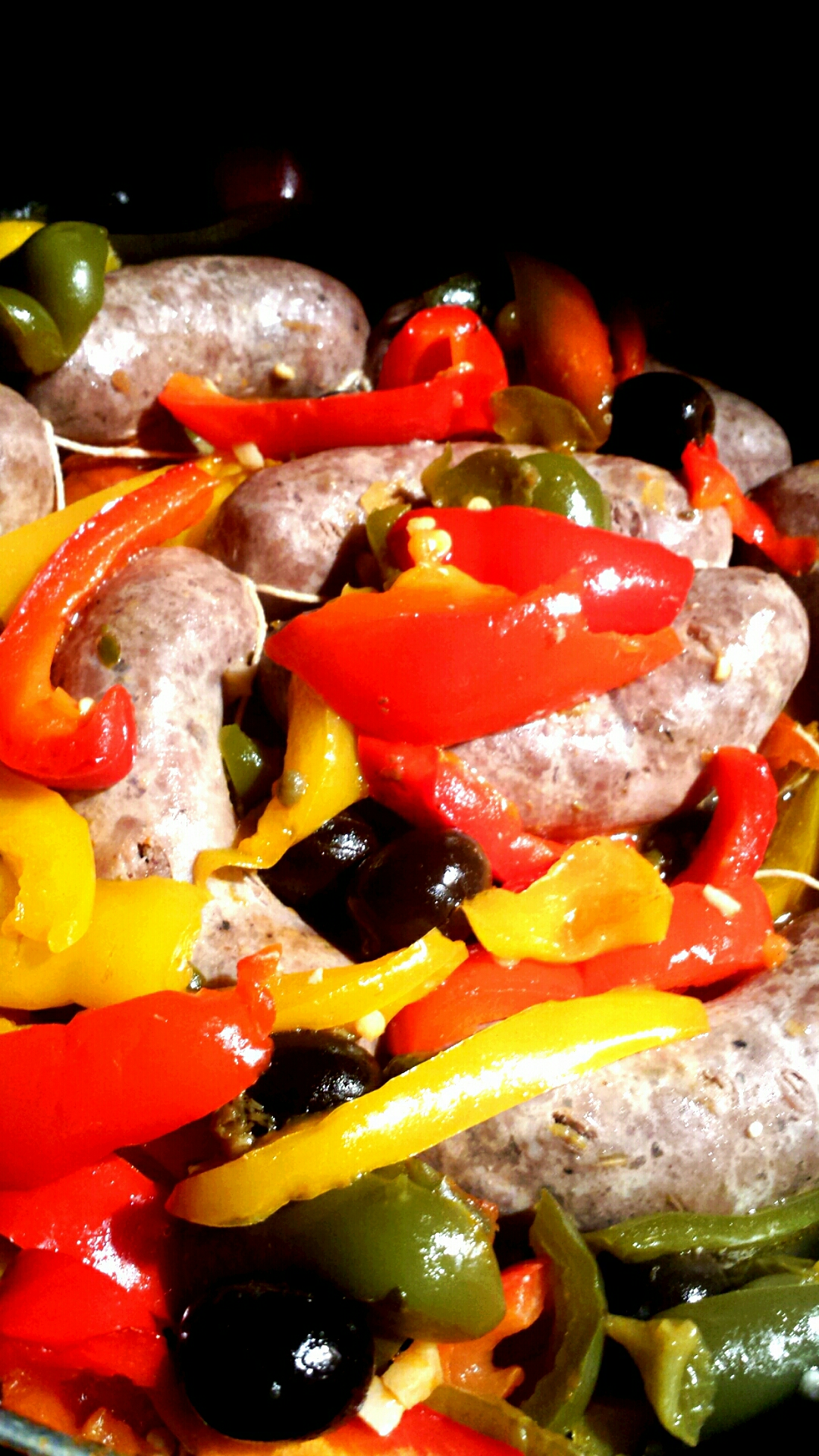 homemade sausages with homemade lachryma christi rose vinegar peppers and olives