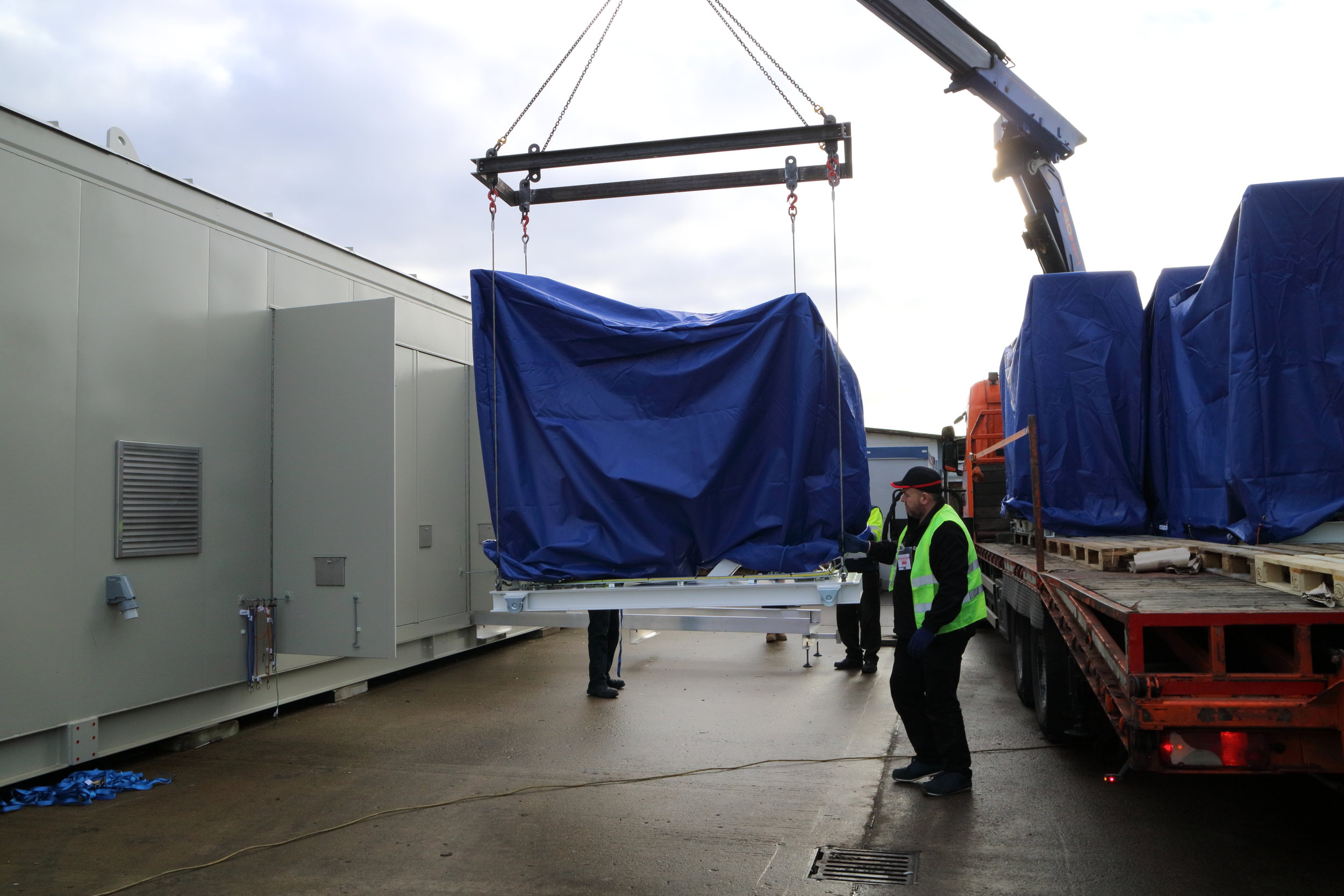 Image 2 - pallet being lifted in to sub.JPG