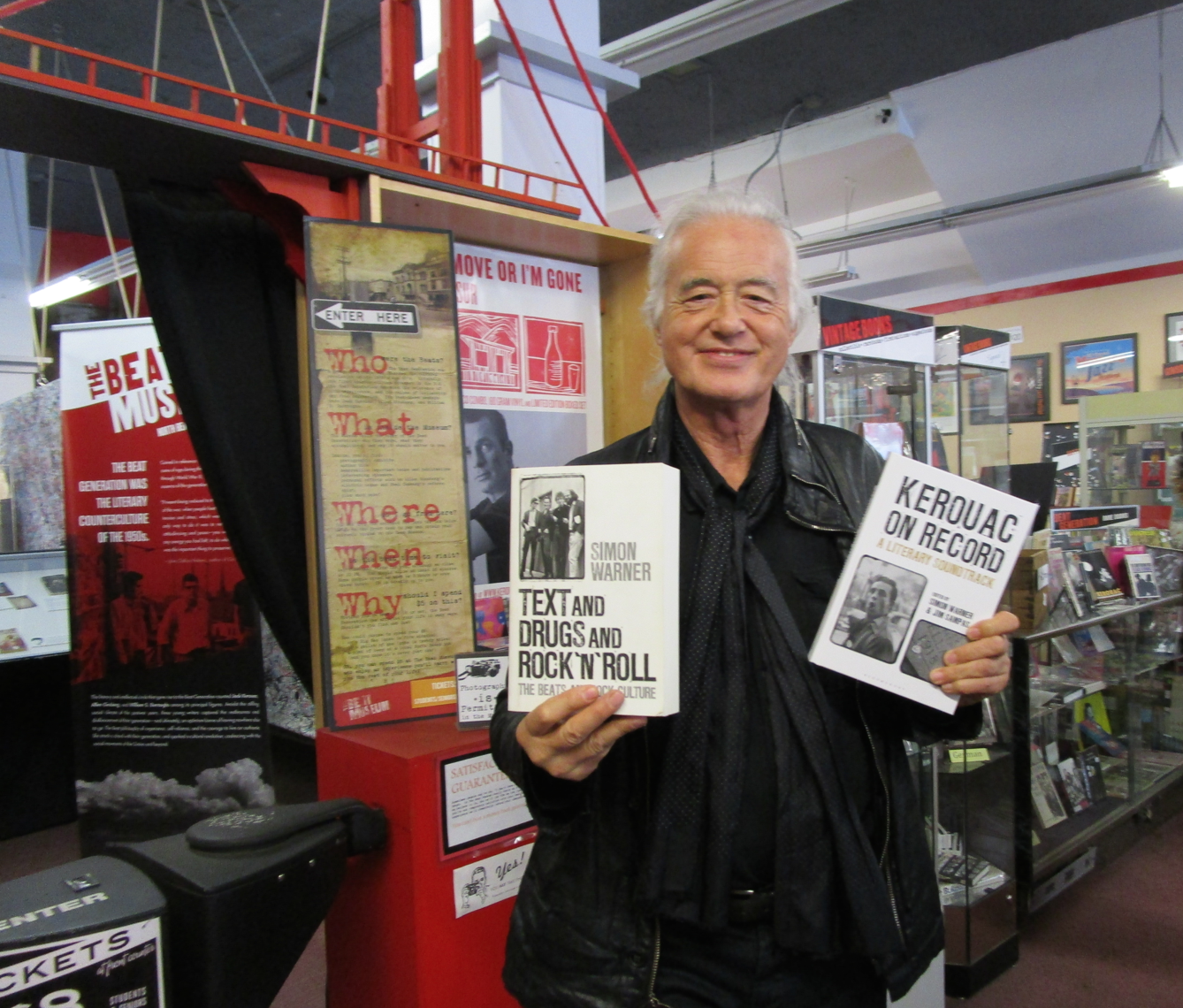 Jimmy Page holding  Kerouac on Record  in his left hand, the book  Simon Warner  and Reimagine Music founder edited for leading publisher Bloomsbury. In Page's right hand is  Simon  Warner's other brilliant work Text and Drugs and Rock and Roll: The Beats and Rock Culture. Also look for poster of film Sampas produced  One Fast Move Or I'm Gone: Kerouac's Big Sur  in the background.