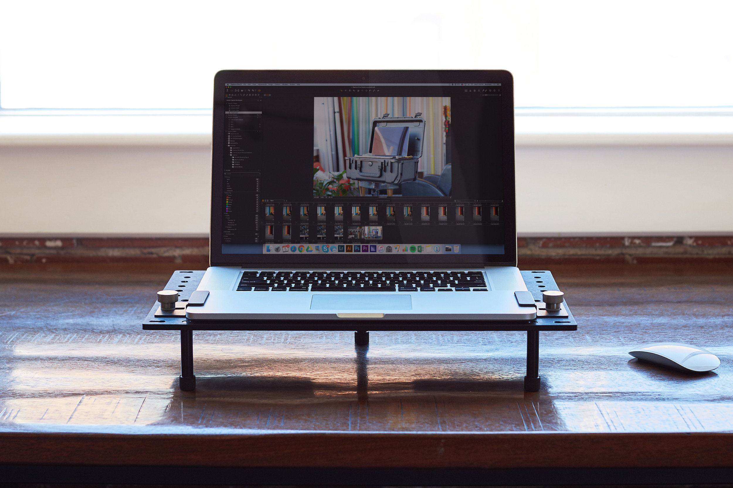 The DigiPlate removed and placed on a desk. The three legs are included to allow elevated operation on a table.