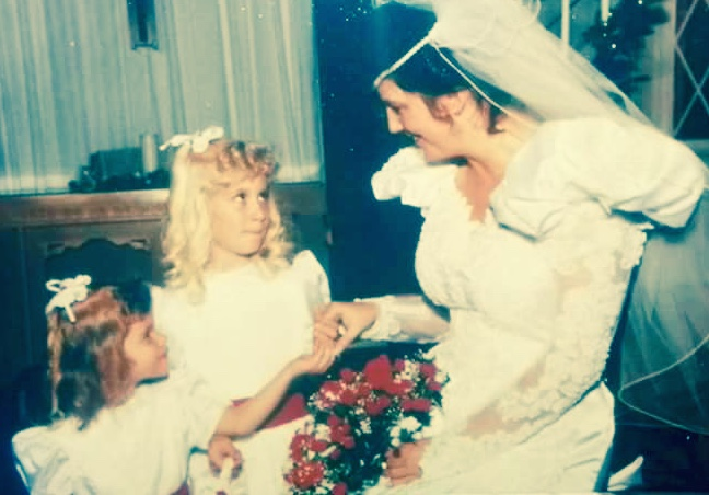 My sister and I as flower girls once upon a time.