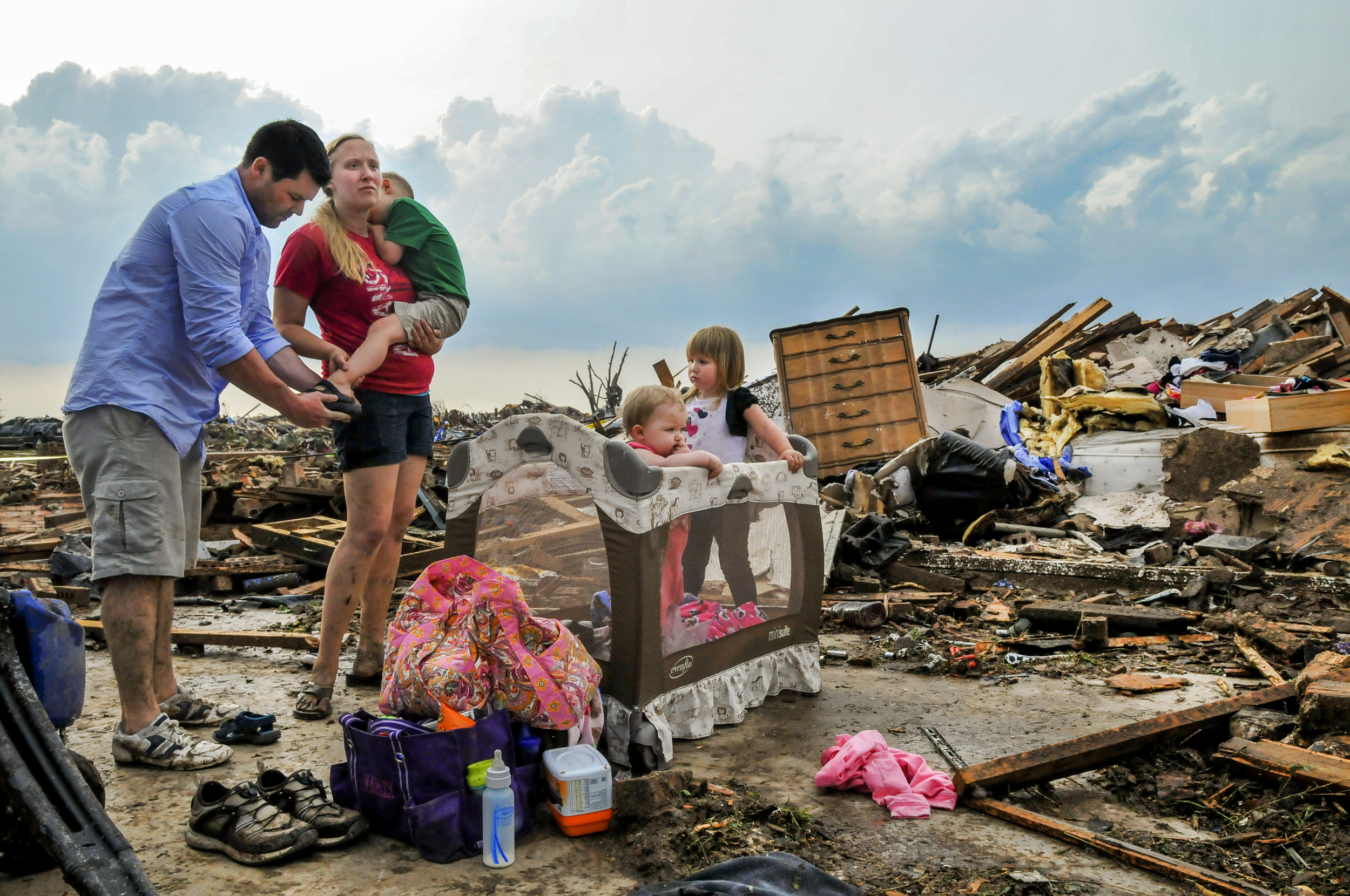 Kelcy Trowbridge, her brother in Law Dustin Weher and her three children L to R: Colby Trowbridge 4, Karley Trowbridge, 1, and Kynlee Trowbridge in front of their destroyed home on May, 20 in the Westmoor Neighborhood near Moore Oklahoma