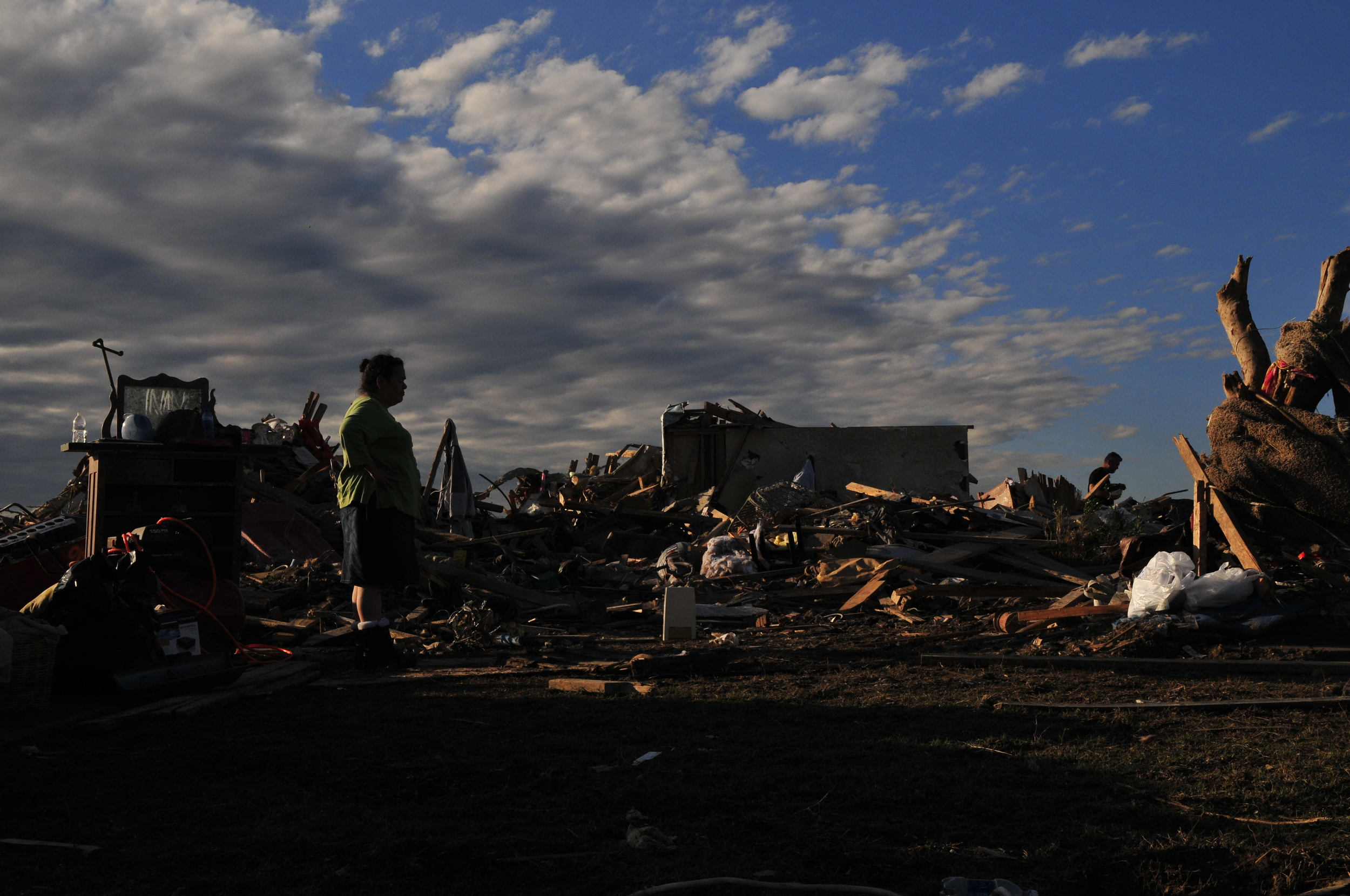 Joyce Moreno stands out front of her brother Gerald's home that was in the direct path of yesterdays EF5 tornado on May 21, 2013 in Moore Oklahoma.
