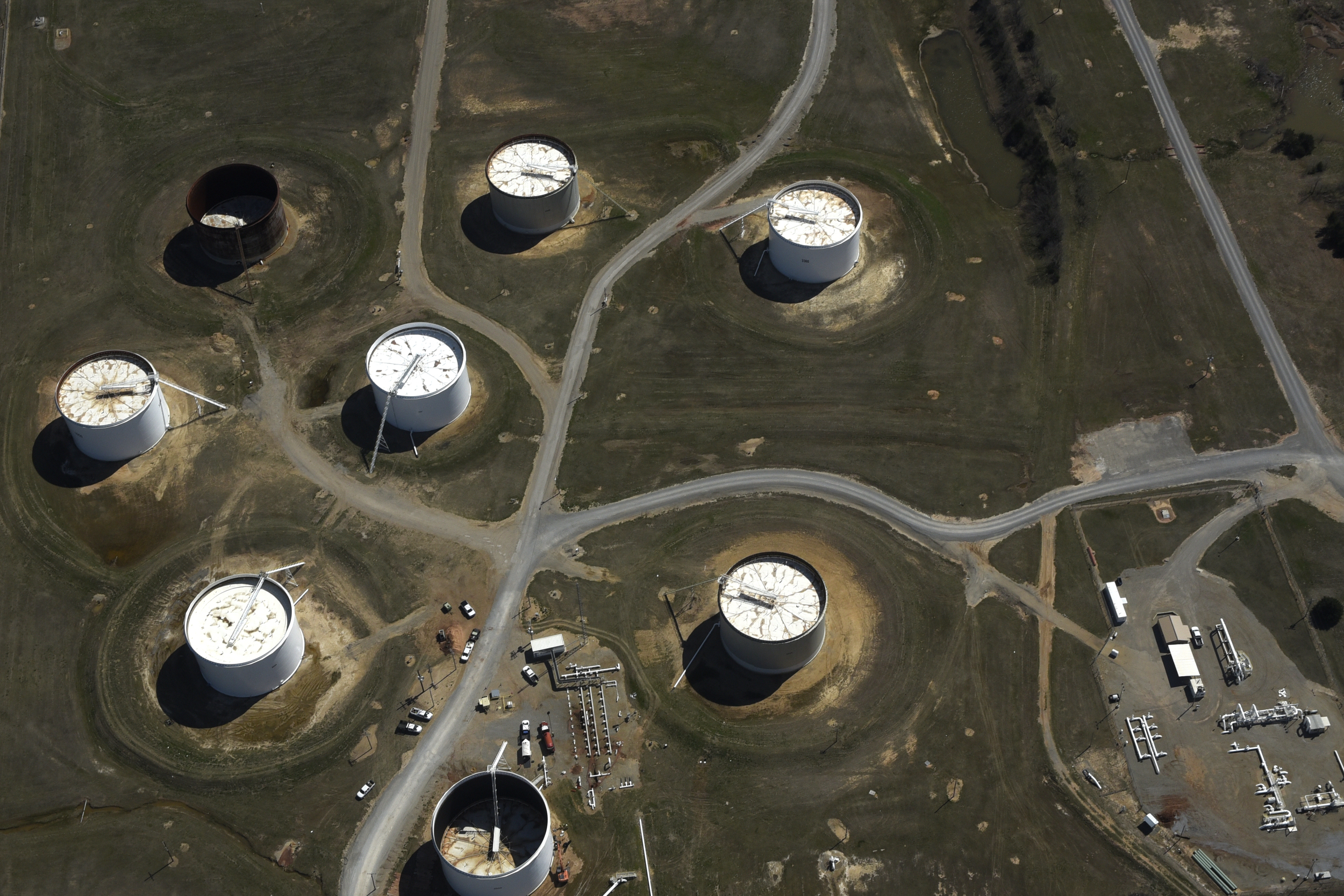 Crude oil storage tanks are seen from above at the Cushing oil hub in Cushing, Oklahoma.
