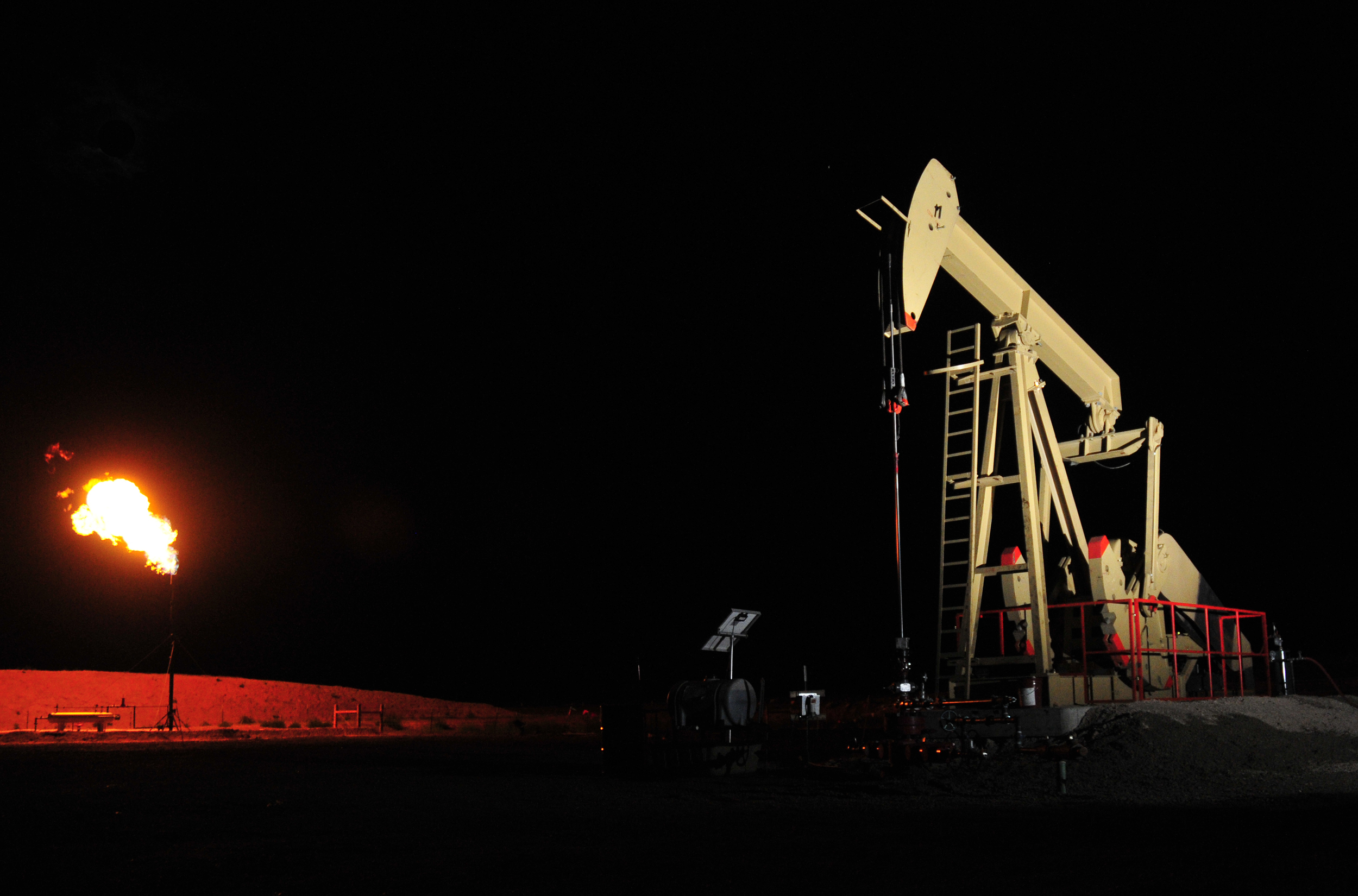 An oil rig operates at night near Pawnee Buttes Colorado