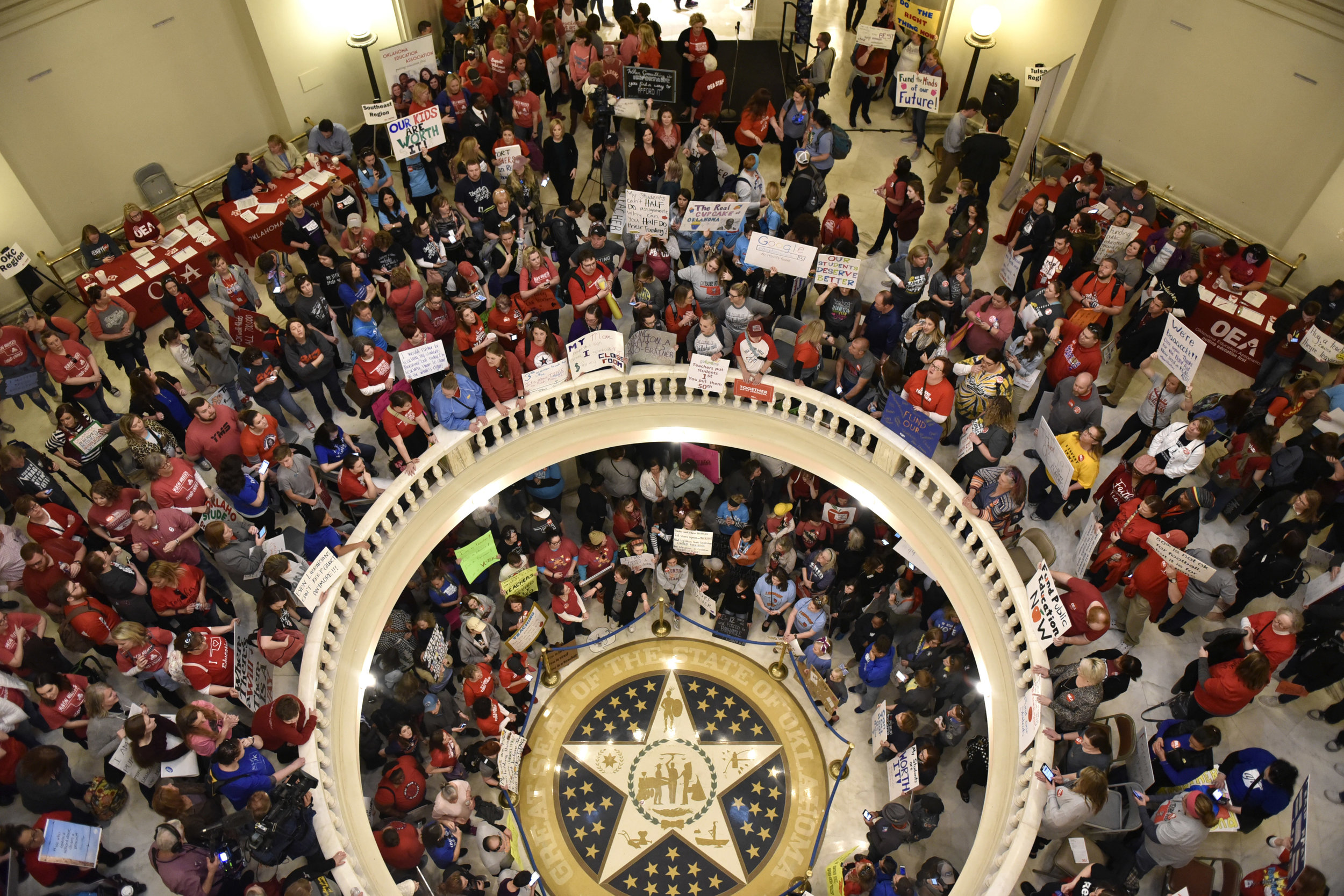 Teachers pack the state Capitol rotunda to capacity on the second day of a teacher walkout to demand higher pay and more funding for education in Oklahoma City, Oklahoma, U.S., April 3, 2018. REUTERS/Nick Oxford