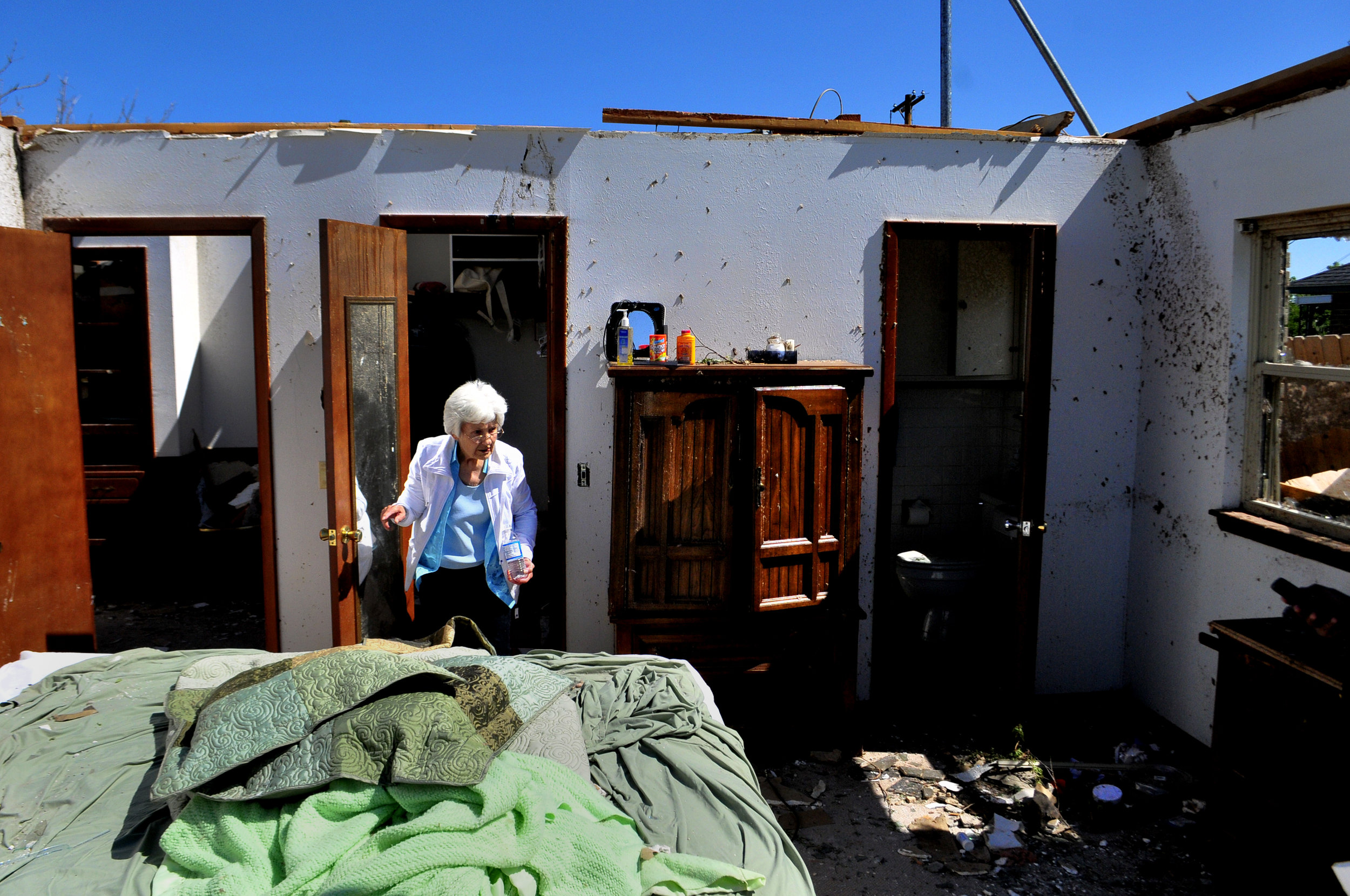 Wilma Nelson, 87, stands in the closet that she took shelter in while a tornado destroyed her home in Woodward Oklahoma on Sunday. Nelson also survived the deadly tornado that struck Woodward Oklahoma on April, 9 1947.