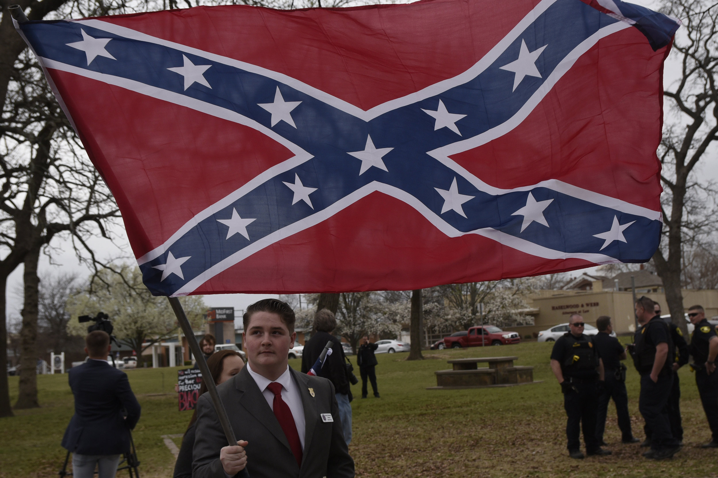 Mason Page displays a Confederate battle flag during a rally held by Sons of Confederate Veterans in Shawnee, Oklahoma, U.S. March 4, 2017. REUTERS/Nick Oxford