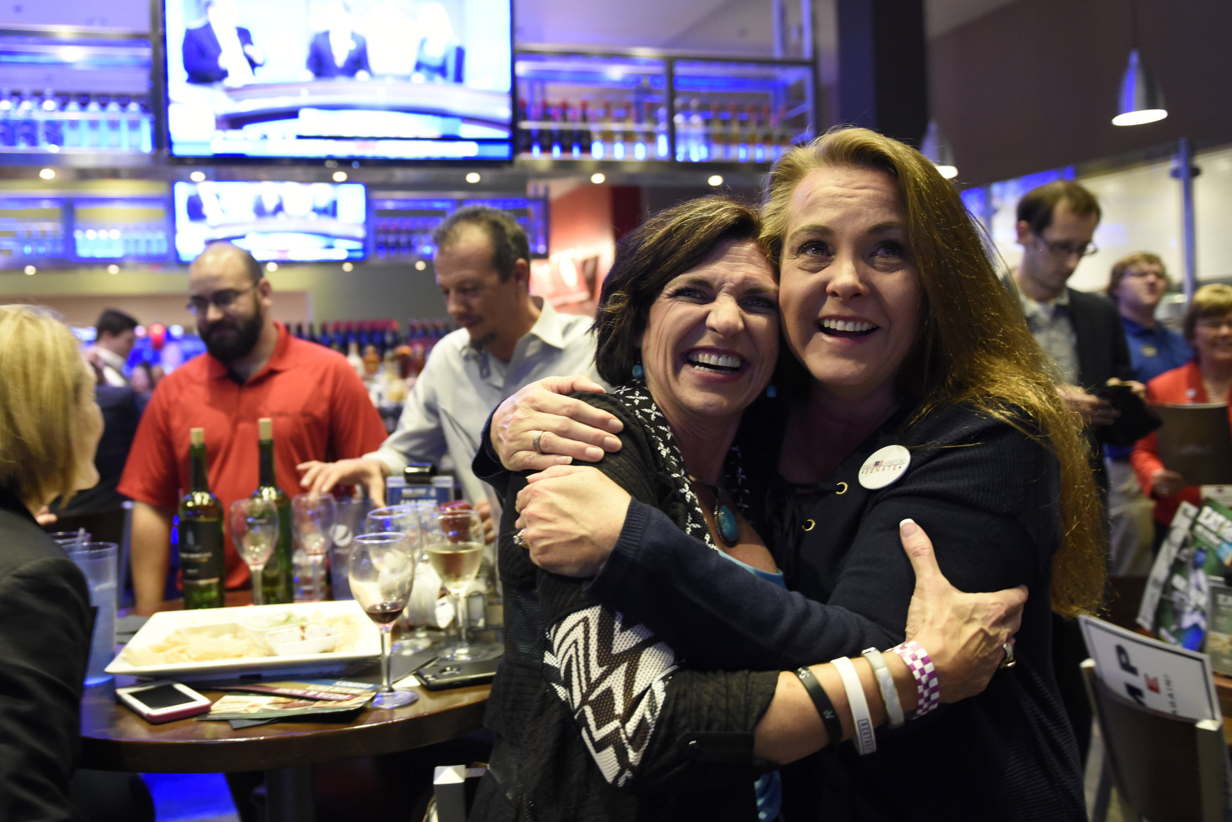 Chandra Ford (L) and Tempe Perreira celebrate as Republican presidential nominee Donald Trump is announced the winner of Ohio at the Oklahoma GOP watch party in Oklahoma City, Oklahoma, U.S. November 8, 2016.  REUTERS/Nick Oxford